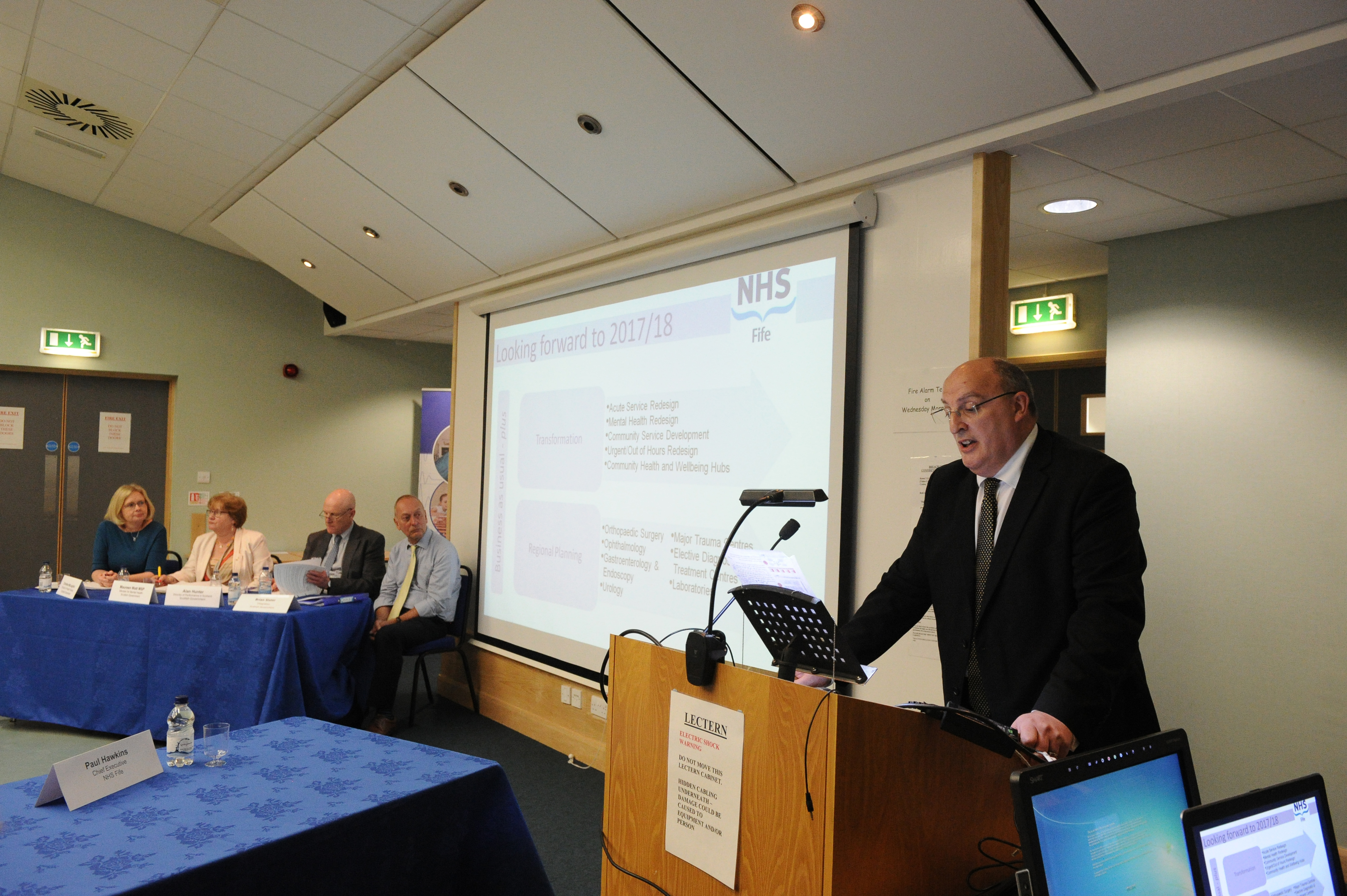 NHS Fife chief executive Paul Hawkins addresses the assembled audience at the annual review.