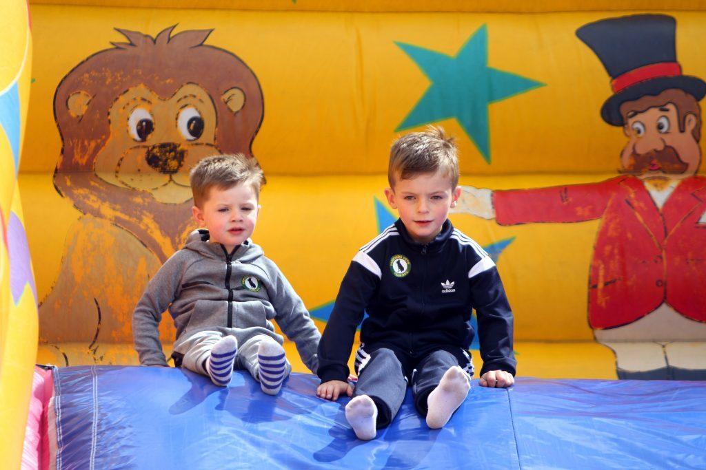Blake Jarret (3) and Kalvin Addison (7) having fun on the inflatable slide.