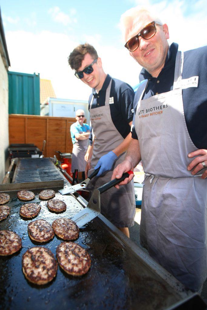 Thomas and Scott Jarron manning the BBQ.