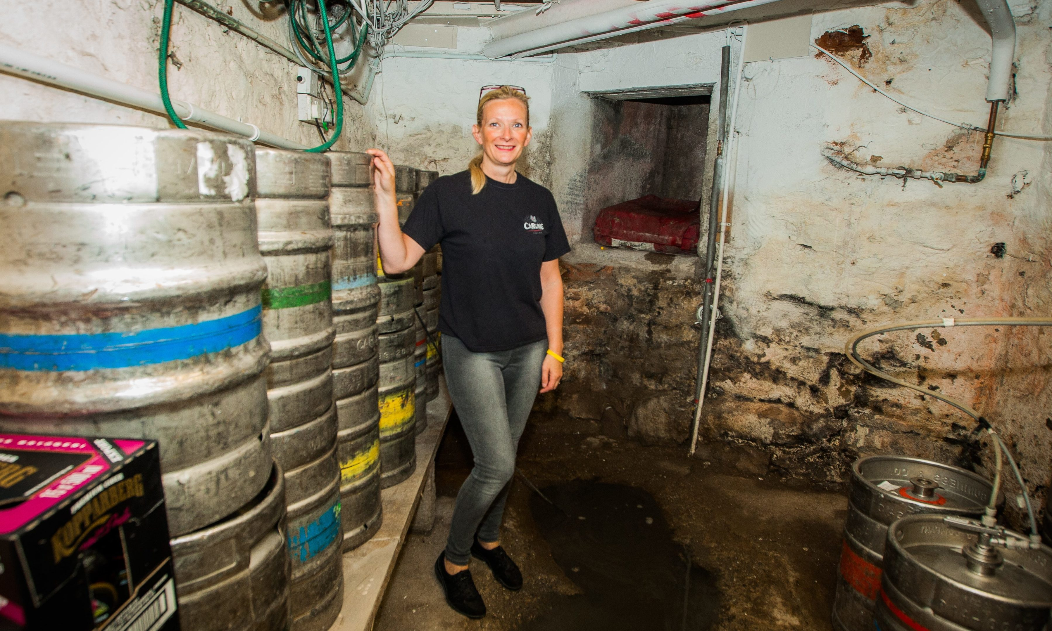 Christie's owner Helen Ratcliffe with the cellar wall.
