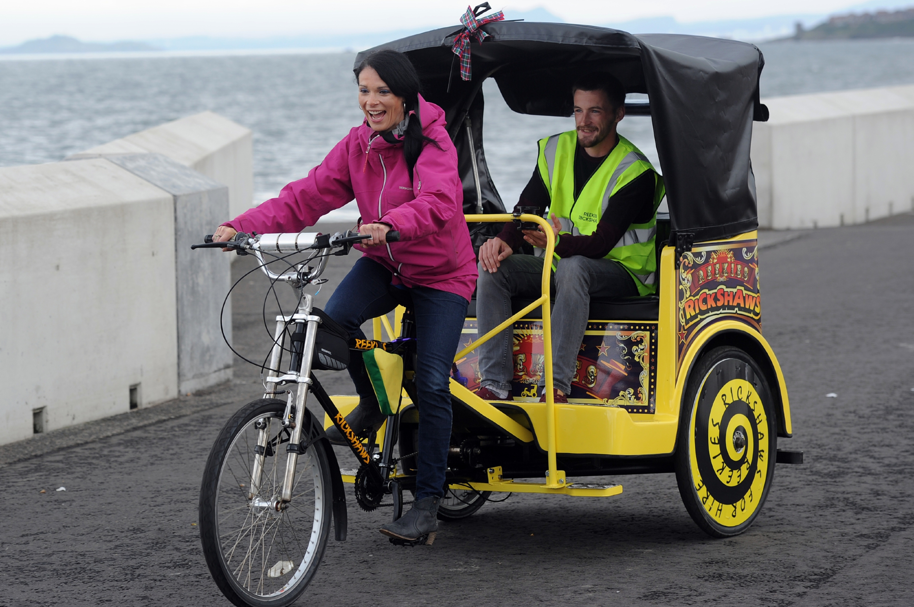Gayle has a go at pedalling a rickshaw with passenger Danny Bentham, on the Esplanade, Kirkcaldy,