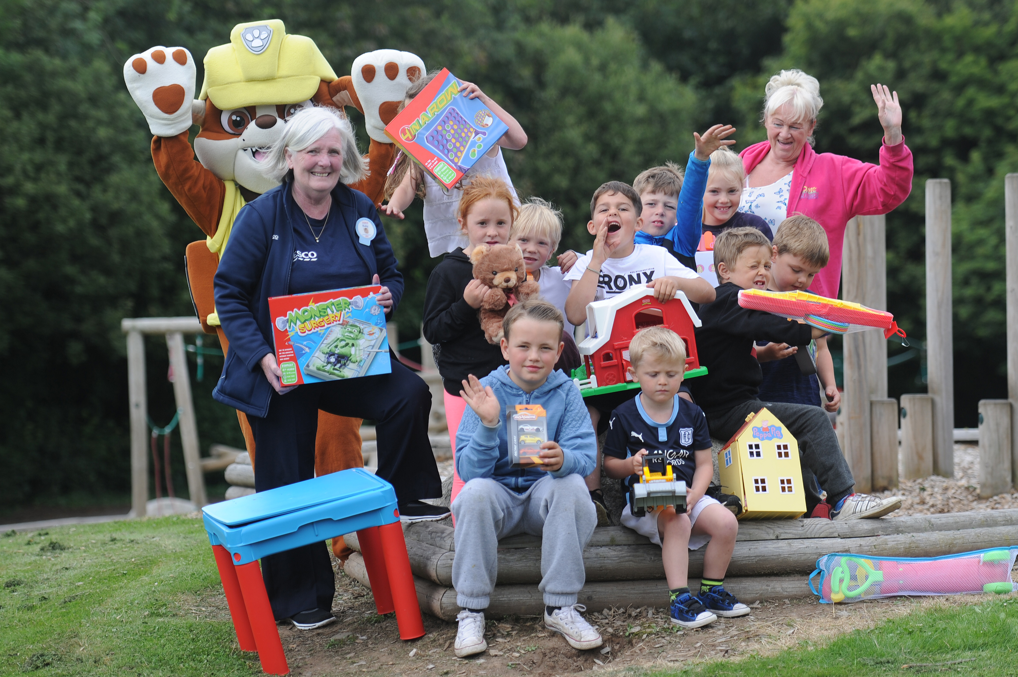 Tesco Kingsway community champion Ruby Young with some of the children who will play with their new toys.