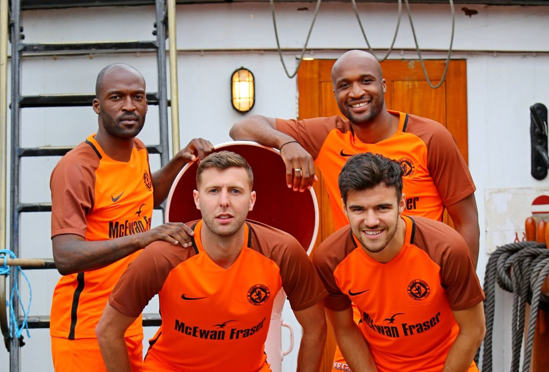 Patrick N'Koyi, Lewis Toshney, William Edjenguele and Scott Fraser in the new kit. Pic: Dundee United FC.