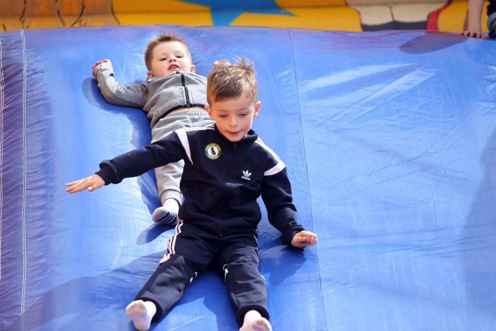 Kalvin Addison (7) and Blake Jarret (3) having fun on the inflatable slide.
