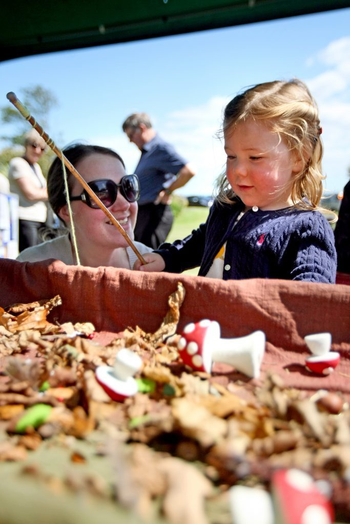 Alison and Morgan Amond from Cleppington Road trying out a red squirrel foraging game at the Dundee Countryside Rangers stall.