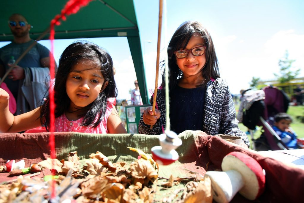 Isra and Laibi Salimi from Broughty Ferry Road trying out a red squirrel foraging game.