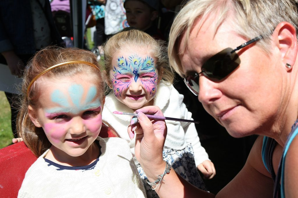 Jasmine Reynolds and Lily Tosh having their faces painted.