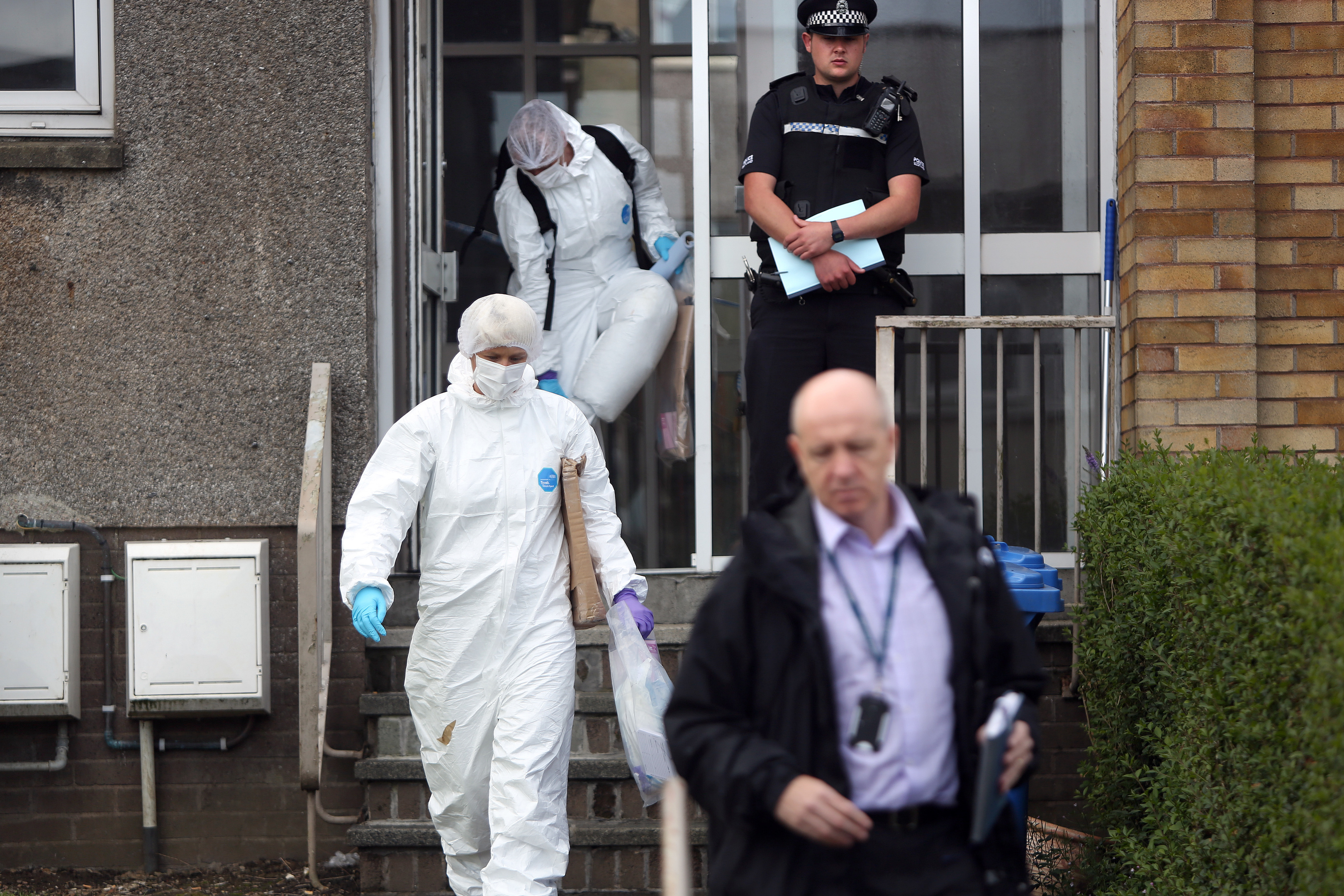 Forensics officers have been examining the flat.