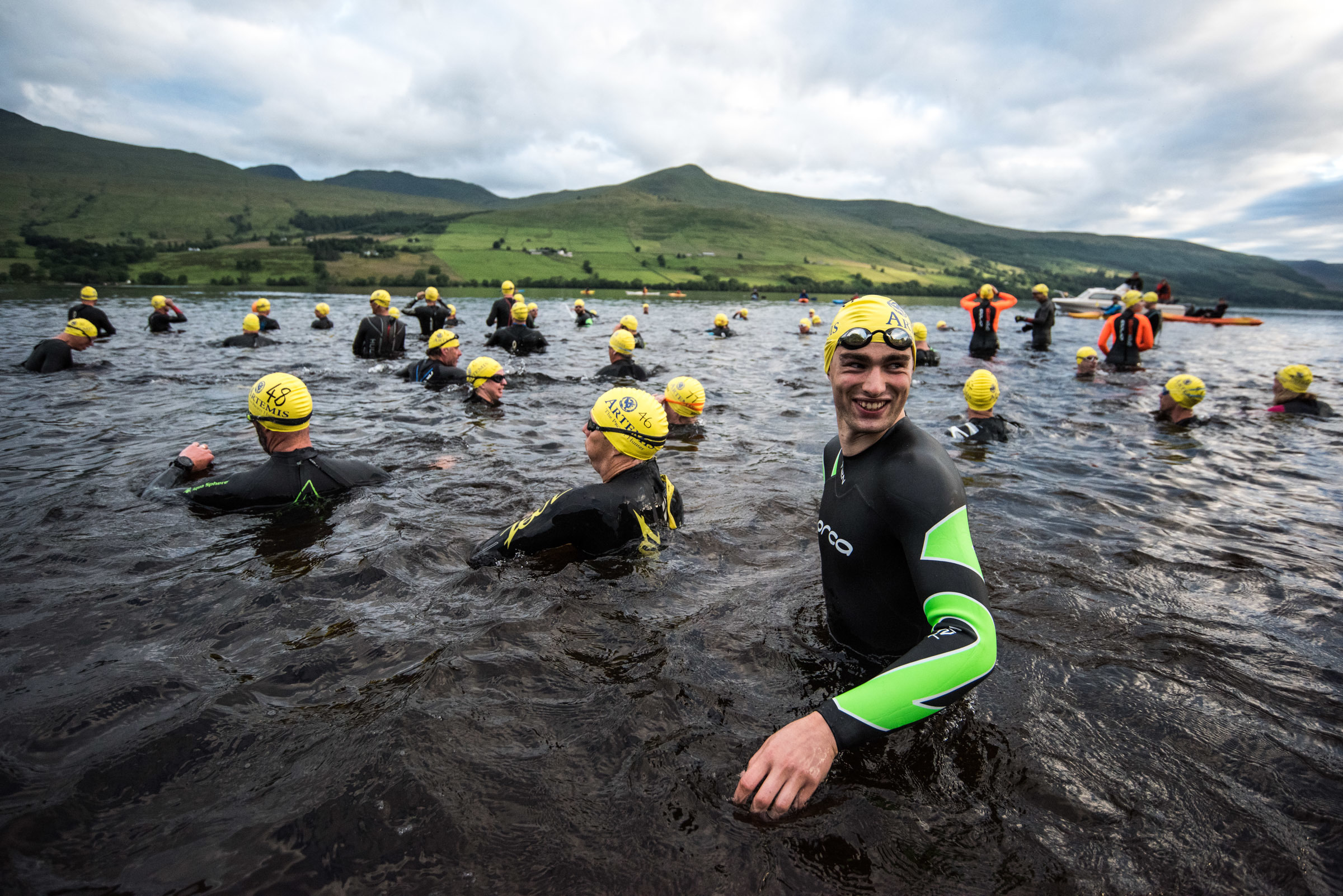 Swimmers step into the water for the start of the Artemis Great Kindrochit Quadrathlon 2017.