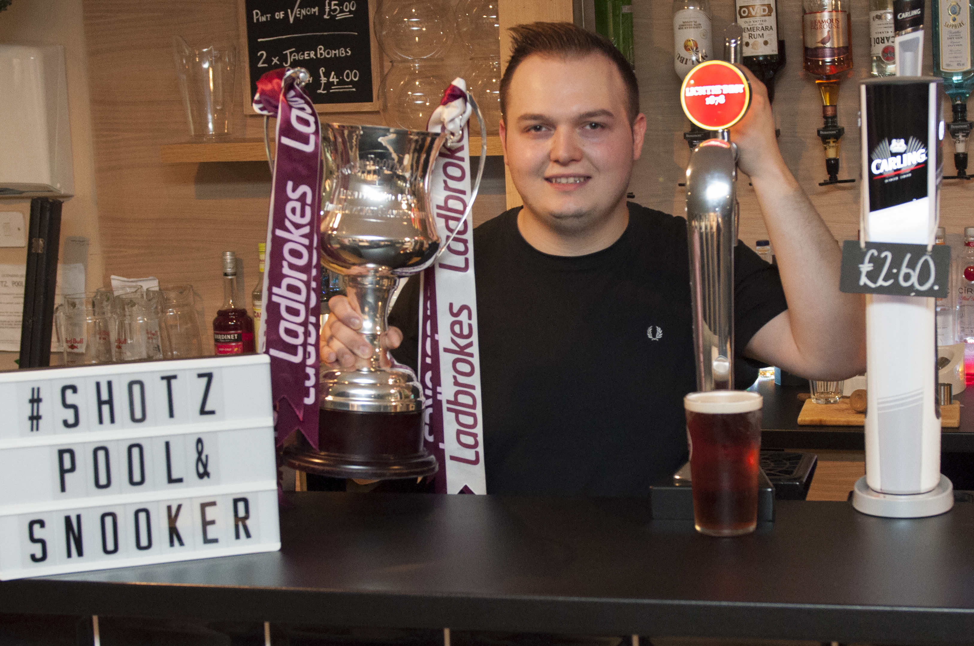 Ryan Fleming with the title trophy and the Lichtie Best Ale.