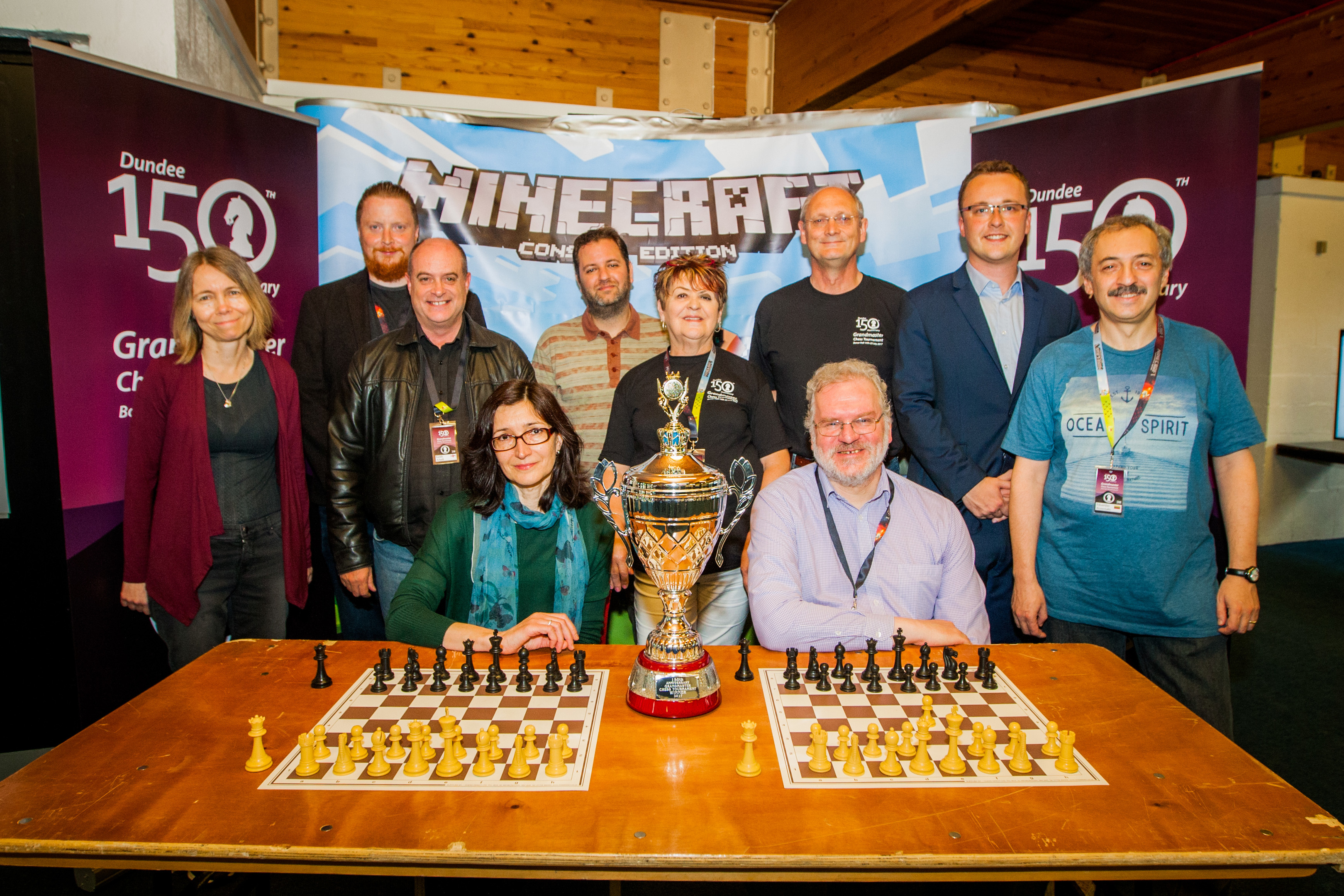 Event organiser Jean Chalmers in the centre alongside most of the Chess Grandmasters playing in the event