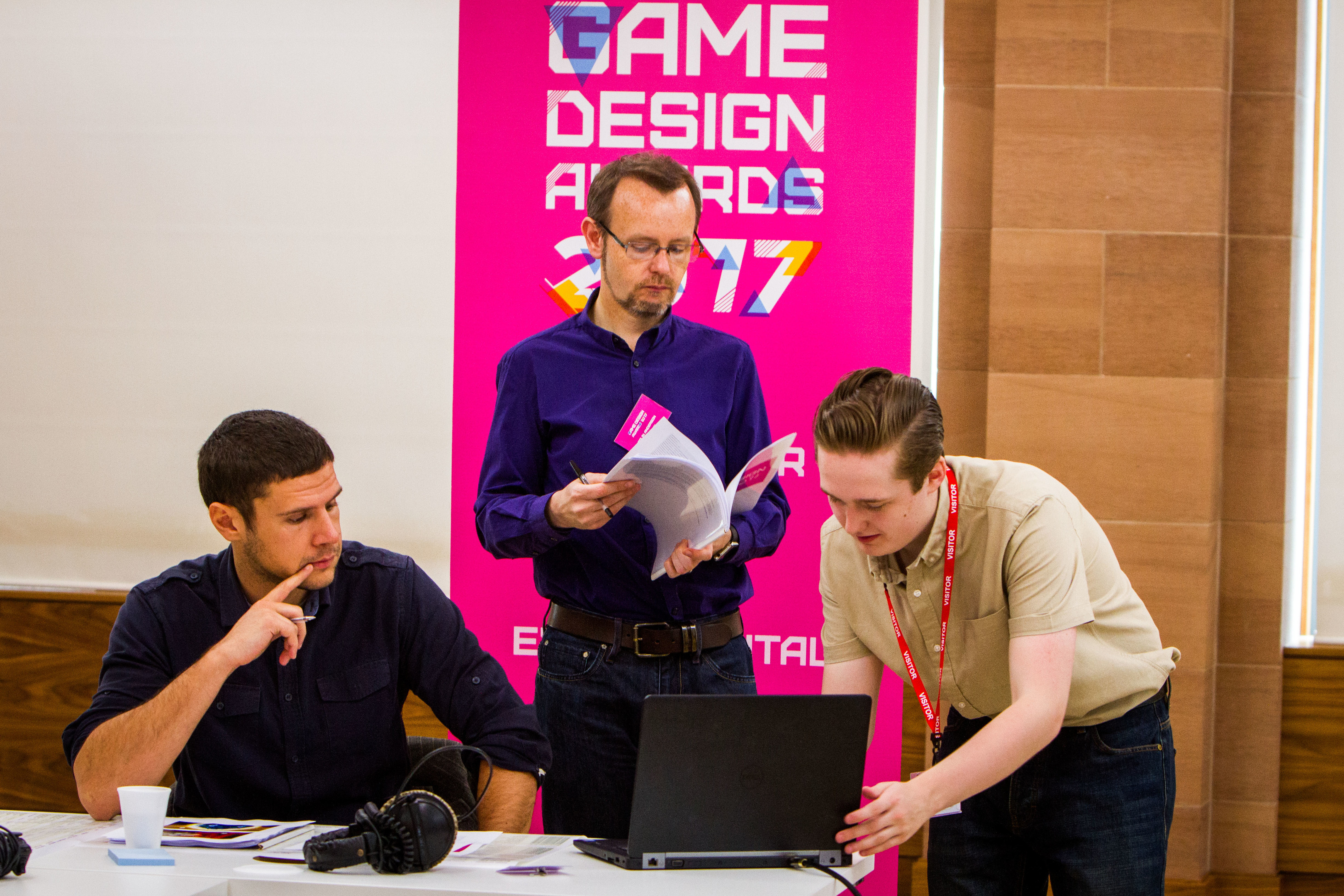 Christos Michalakos of Abertay University, Denki managing director Colin Anderson and Blair Flight of DC Thomson during the judging.