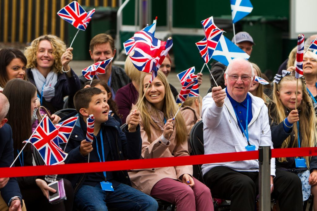 Crowds gathered to see The Queen. Highland Spring.