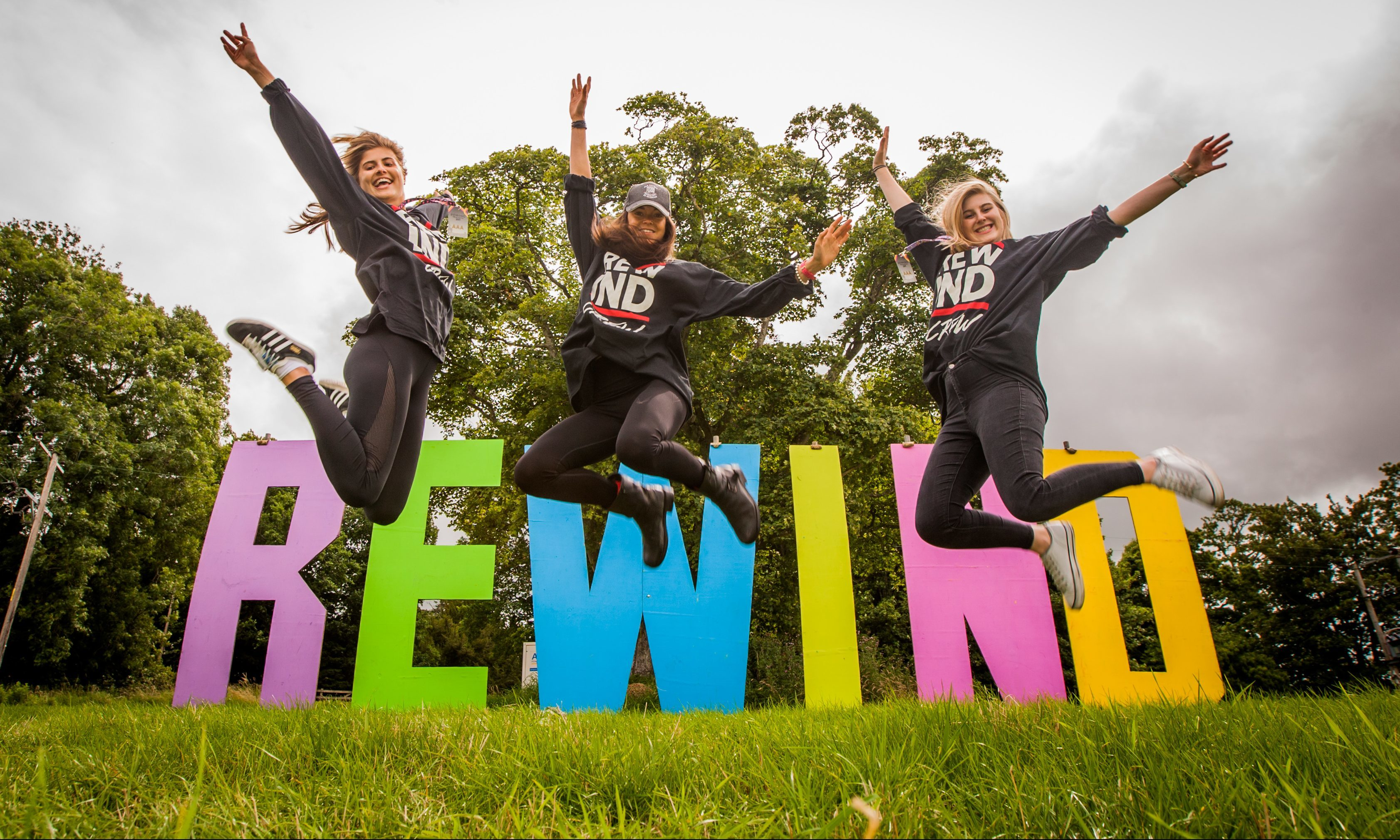 Crew members Isobel Peacock, Francesca Heartfield and Olivia Peacock are jumping for joy at being back at Rewind Scotland.