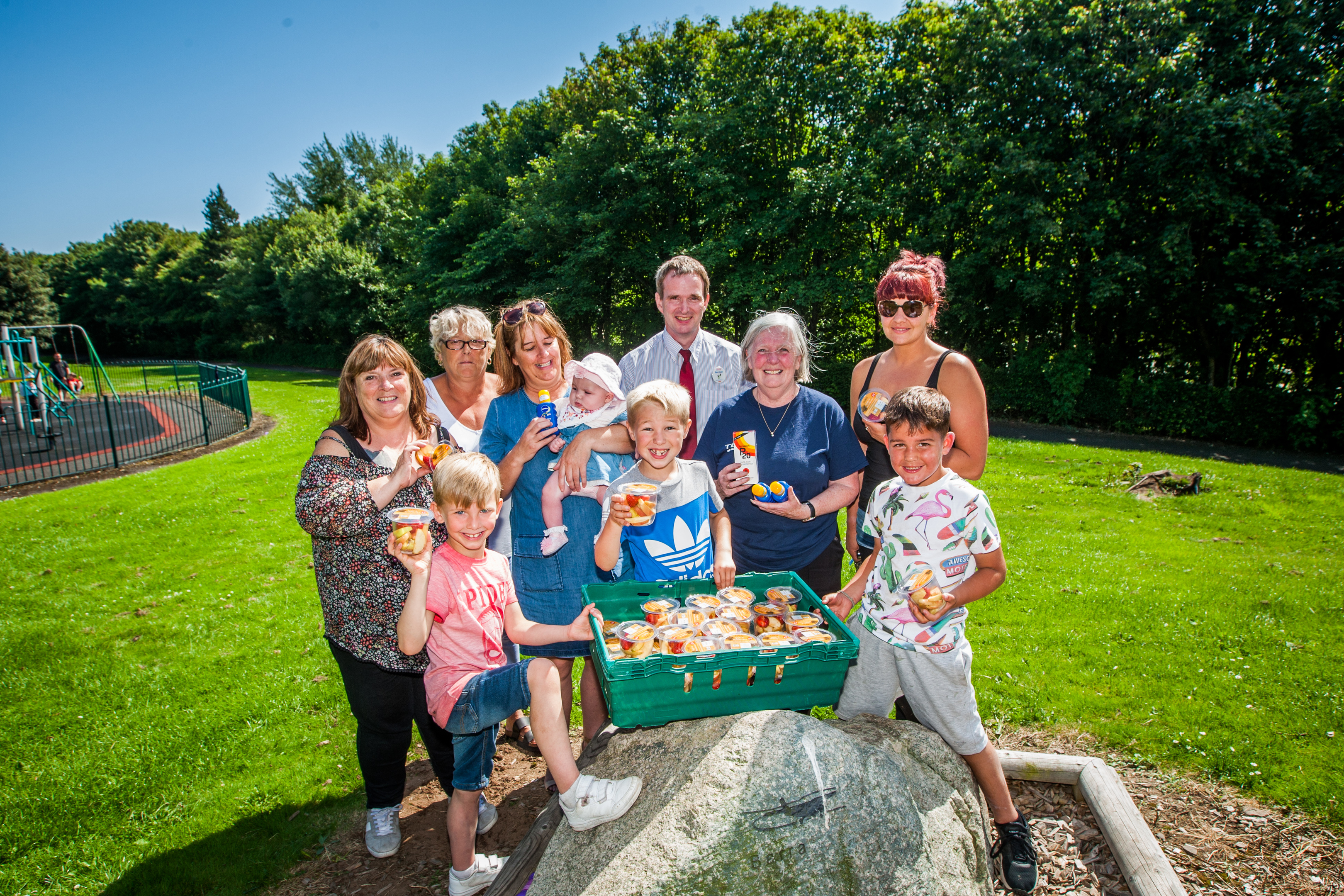 Ruby Young and Norman Smith (Tesco Kingsway, centre) alongside community members. Mill O Mains Playpark, Dundee.