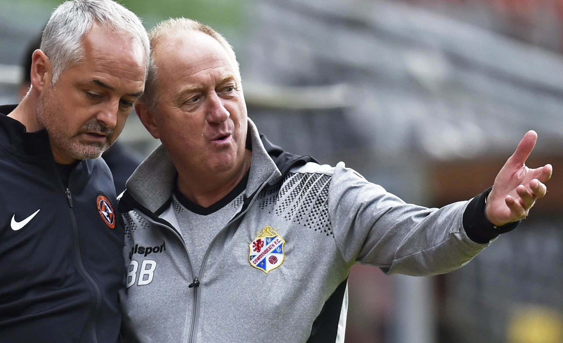 United boss Ray McKinnon and Billy Brown.