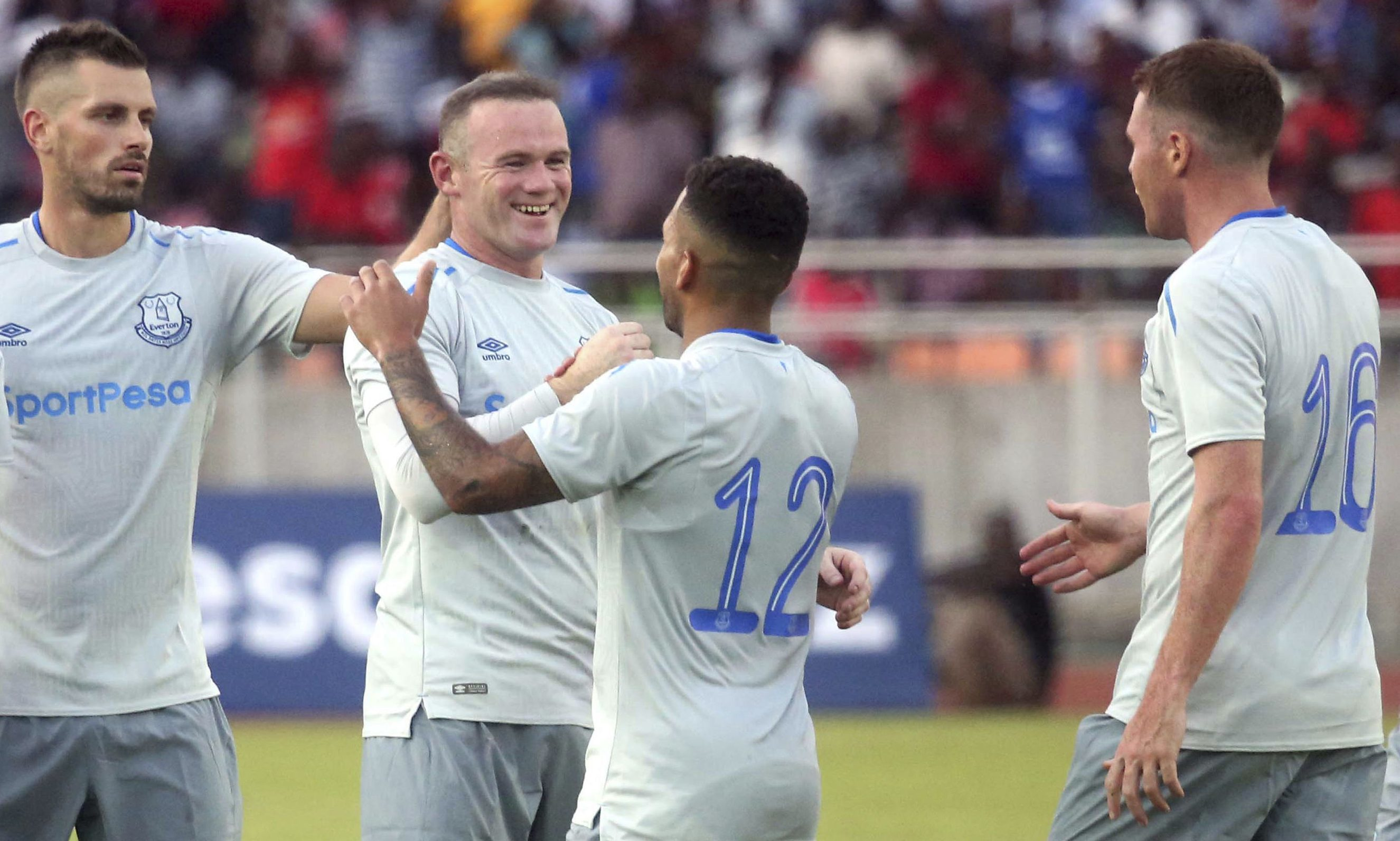 Everton striker Wayne Rooney, 2nd left, is congratulated by teammates after he scored a goal against Kenya's Gor Mahia.