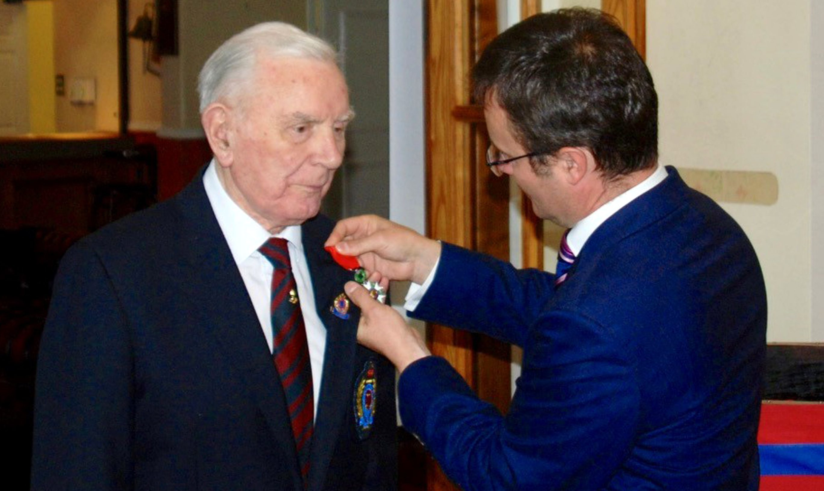 Irvine Rae receiving the Legion d'honneur, France's highest honour for his role in the D-Day landings, from French Consul General in Scotland Emmanuel Cocher at Leuchars in Fife.