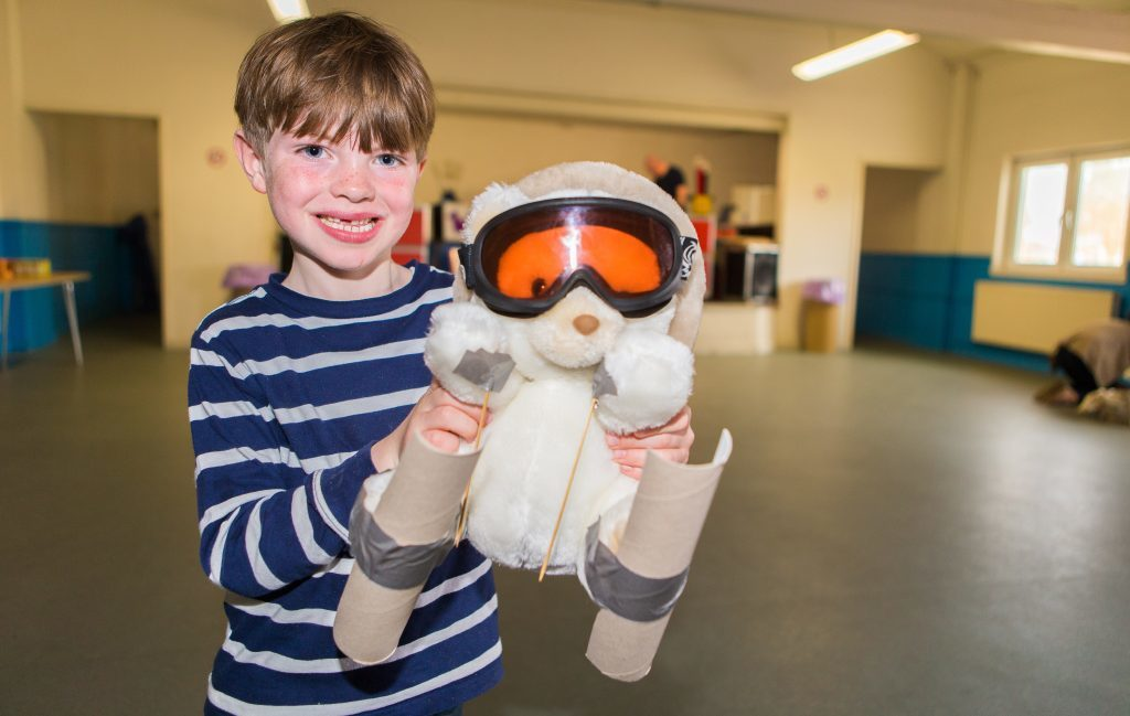 Picture Shows: Rafferty Low (6) from Broughty Ferry with Polarbear Skier Bear.