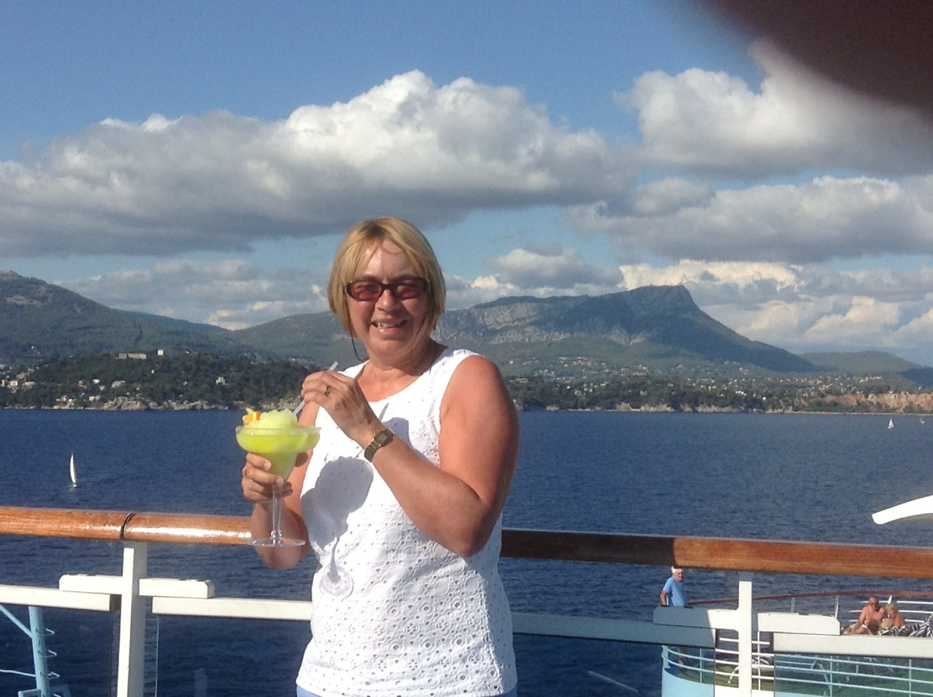 Bridget enjoys a cocktail on board her cruise.
