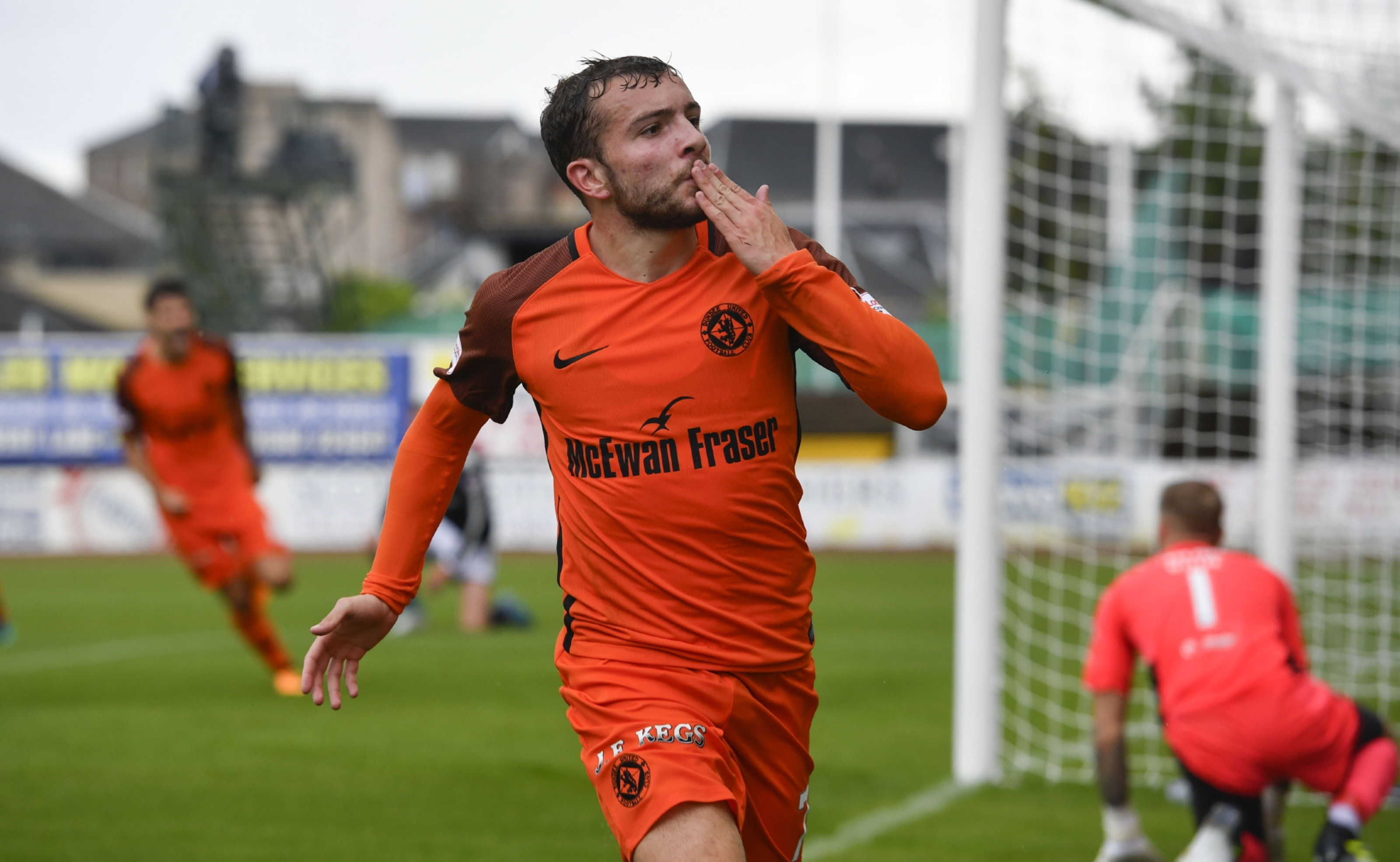 Paul McMullan celebrates his goal against Dundee.