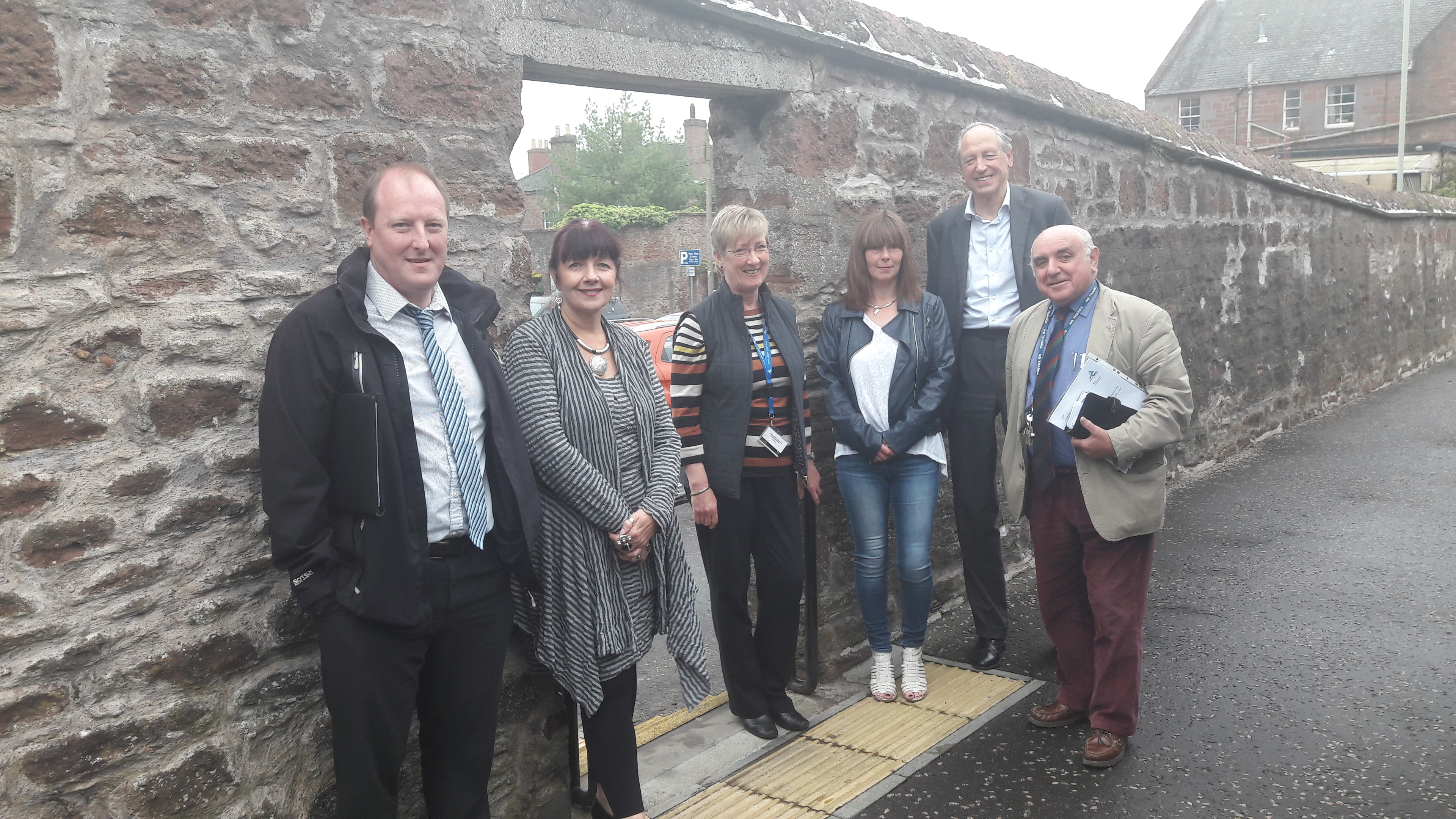 CARS steering group members Paul Fretwell, Councillor Julie Bell, project officer Karen West, Elaine Findlay, Cllr Angus Macmillan Douglas and Cllr Ronnie Proctor at St Colme's Close