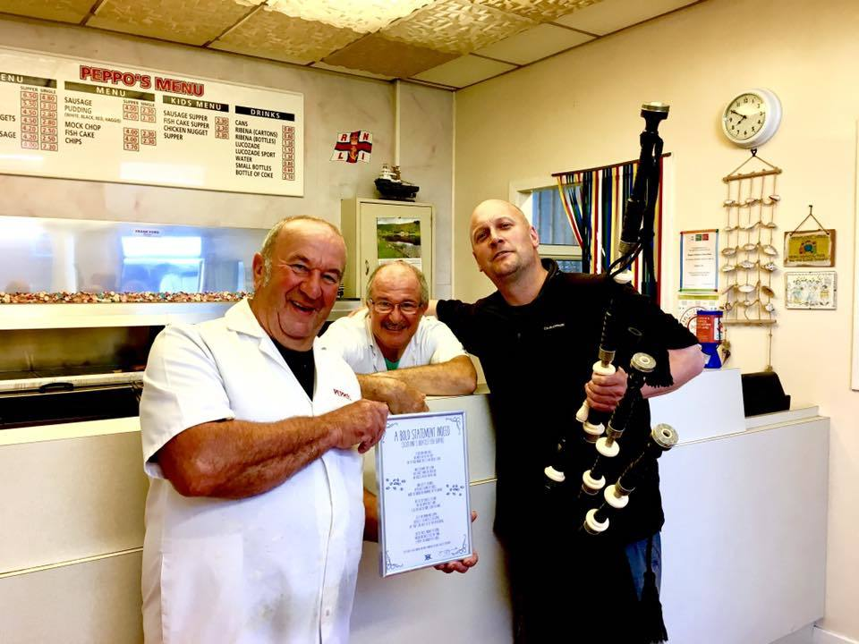 Peppo's owners Johnny and Frank Orsi with Johnny Gauld who wrote a poem honouring the Arbroath shop's fish supper.