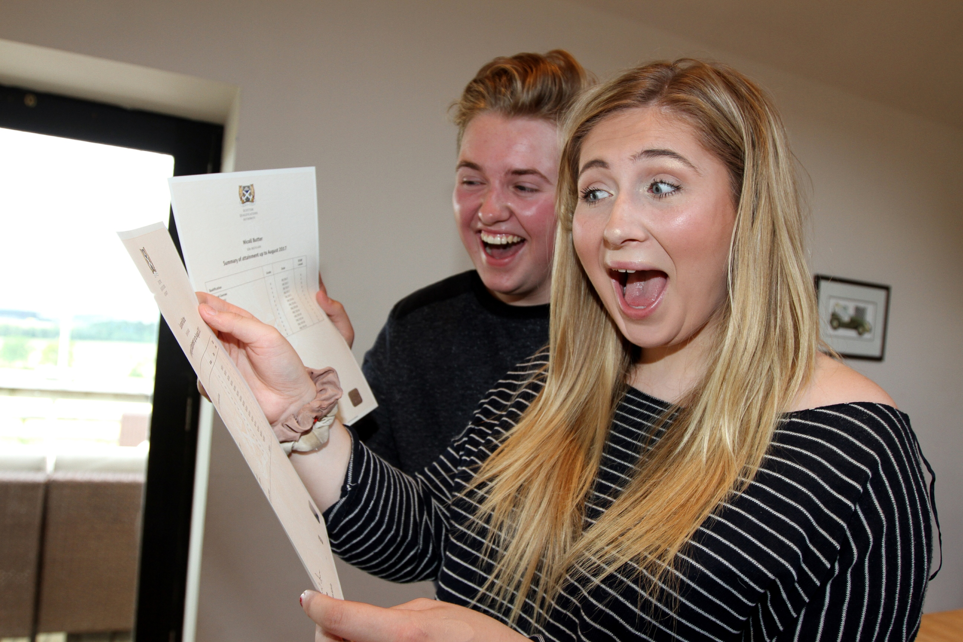 Nicoll and Susie Butter opening their exam results at home on Tuesday.