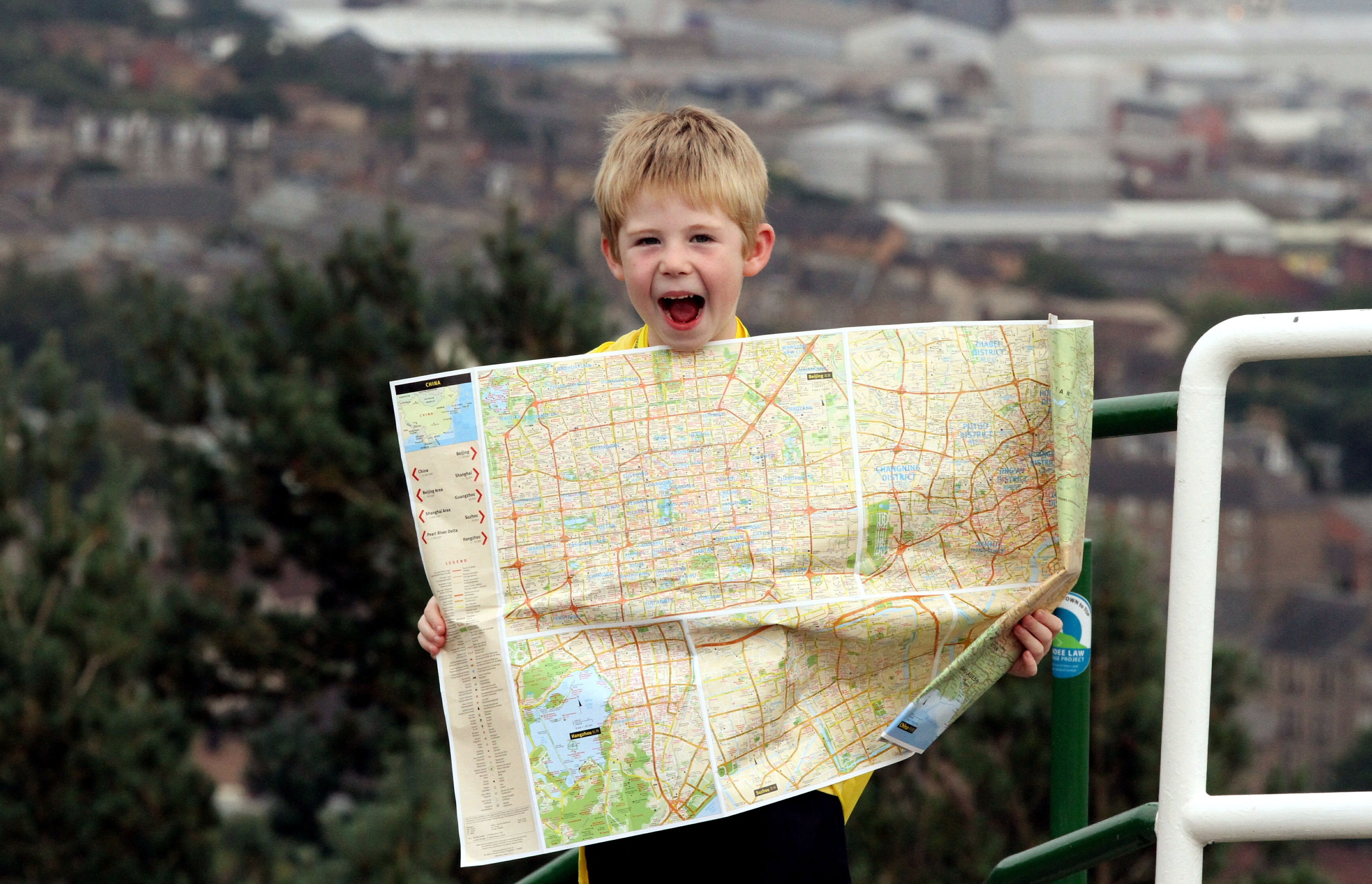 Shay McCormack on top of the Law with his backpack and his map of China, ready to start his walk.
