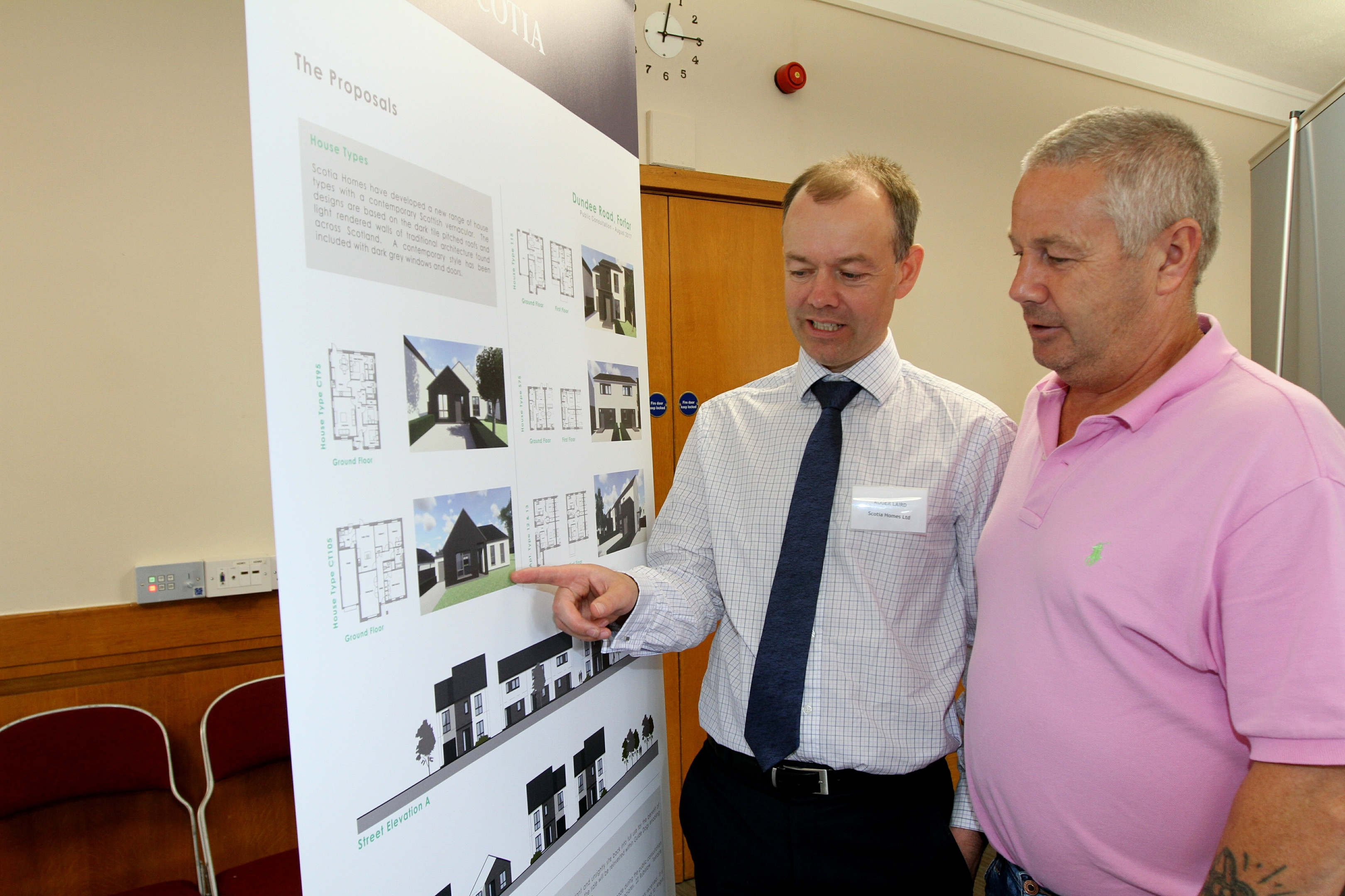 Roger Laird of Scotia Homes with local resident David Taylor