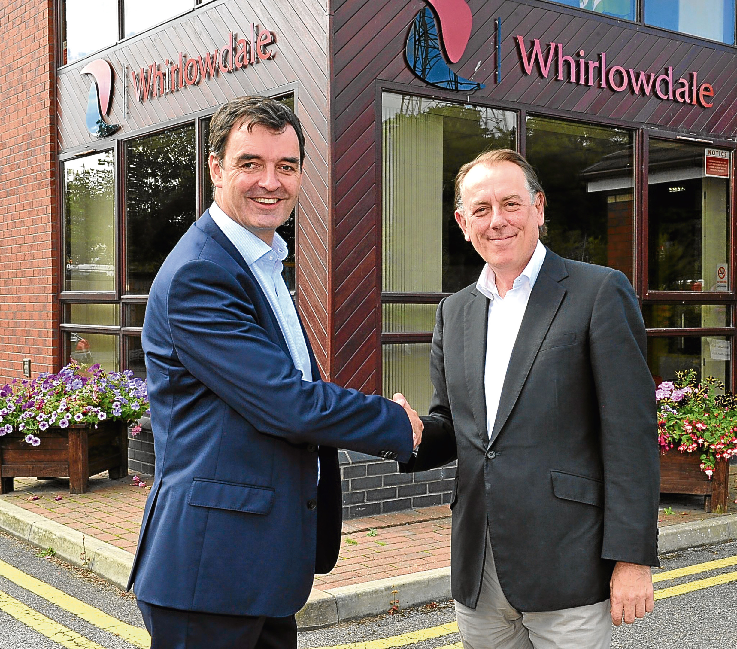 Scott Group operations director Norman Scott with Andrew Pearce of newly acquired Whirlowdale
