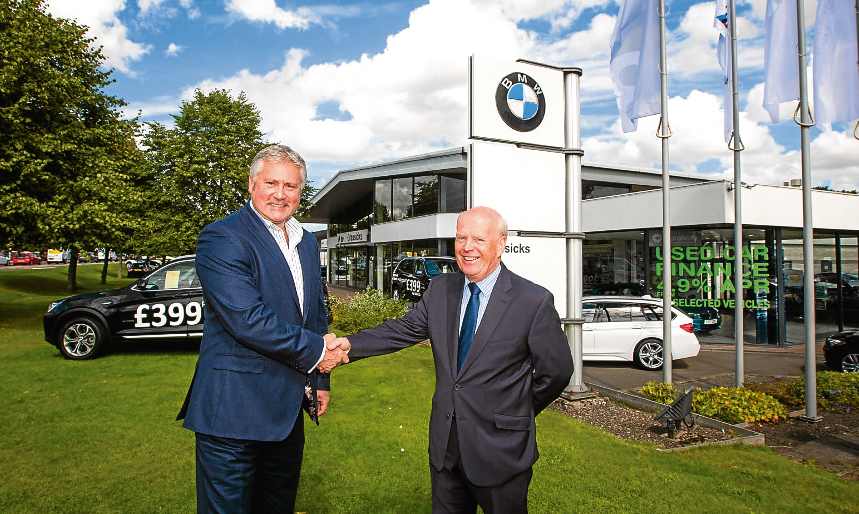 Keith Duncan, the Dundee-raised managing director of Eastern Western Motor Group with (right) Colin Grassick at BMW Grassicks  and MINI at Inveralmond, Perth.
