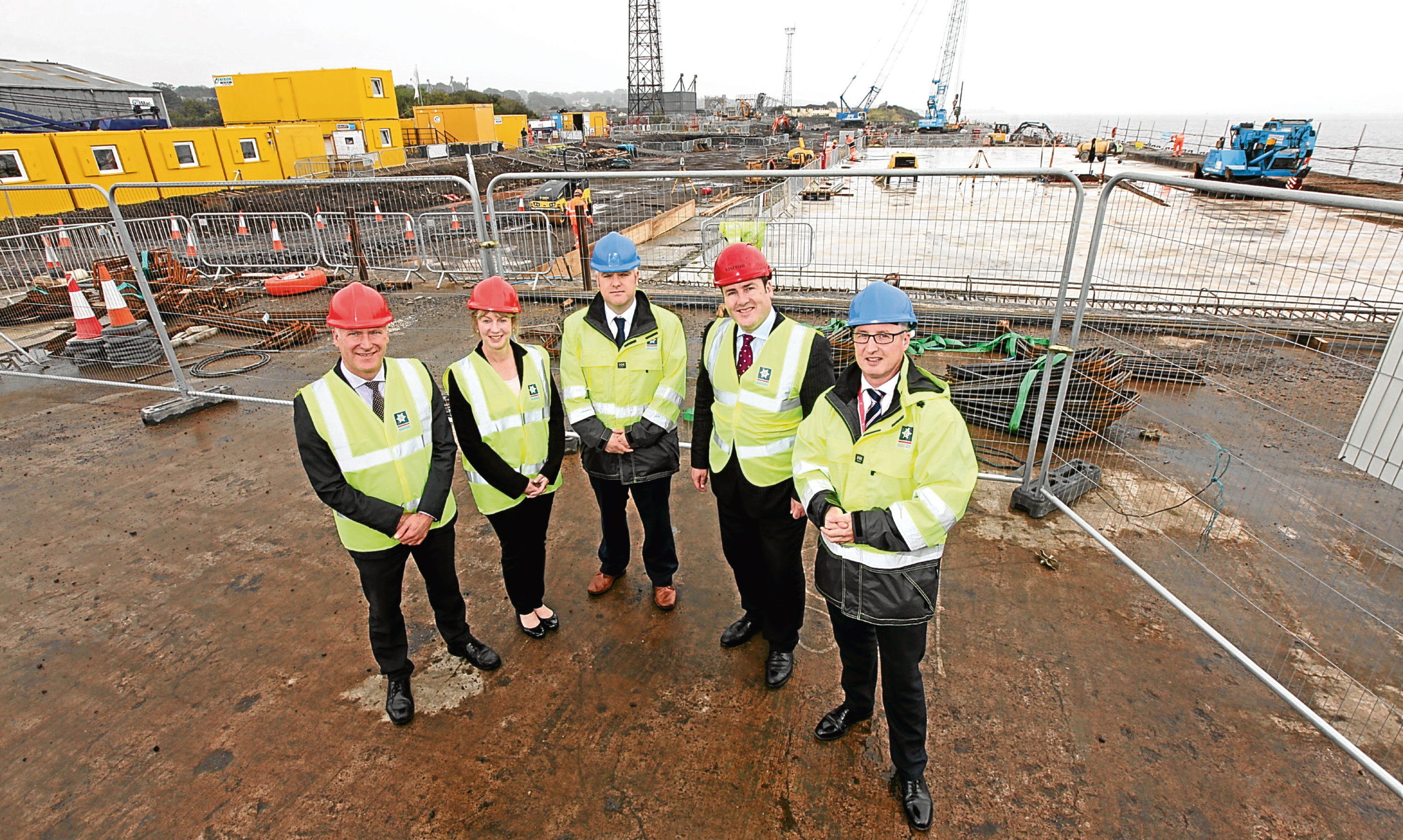 Joe Fitzpatrick MSP, Shona Robison MSP, Dundee Port Manager David Webster, Energy Minister Paul Wheelhouse and Forth Ports COO Stuart Wallace at the docks redevelopment site.