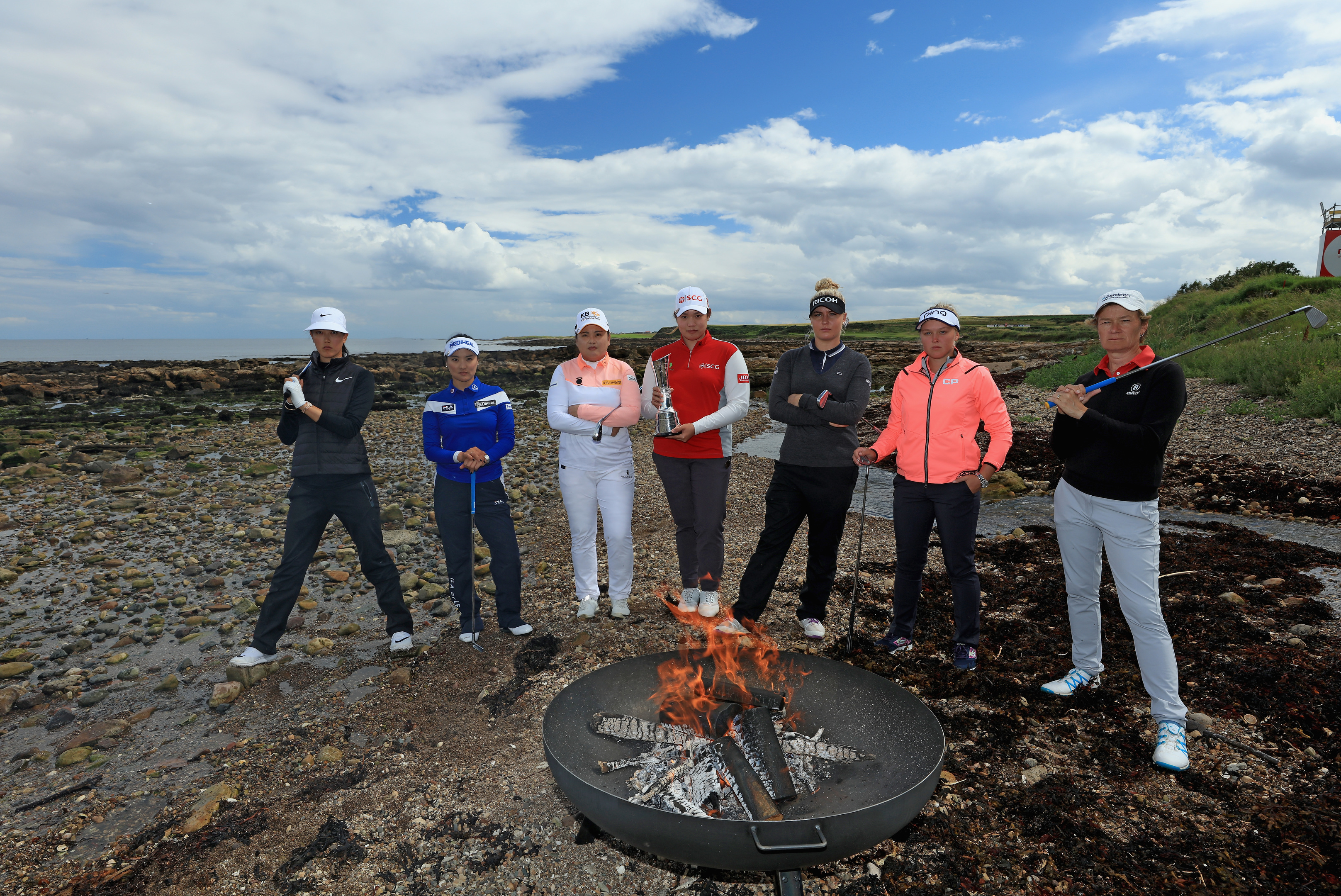 Michelle Wie, So Yeon Ryu, Inbee Park, Ariya Jutanugarn, Charley Hull, Brooke Henderson, and Catriona Matthew at the official photocall for the Ricoh Women's British Open at Kingsbarns.