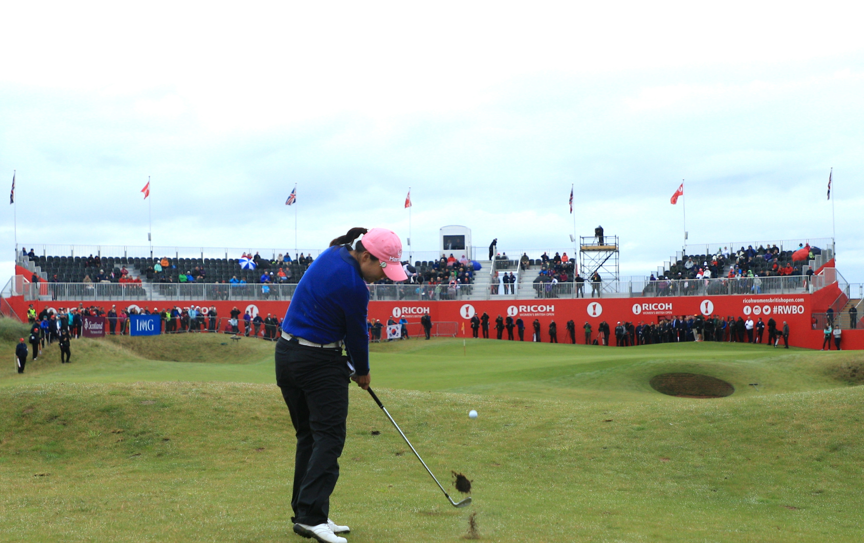 In-Kyung Kim hits her second shot into the 18th green on her way to victory in the Ricoh Women's British Open.