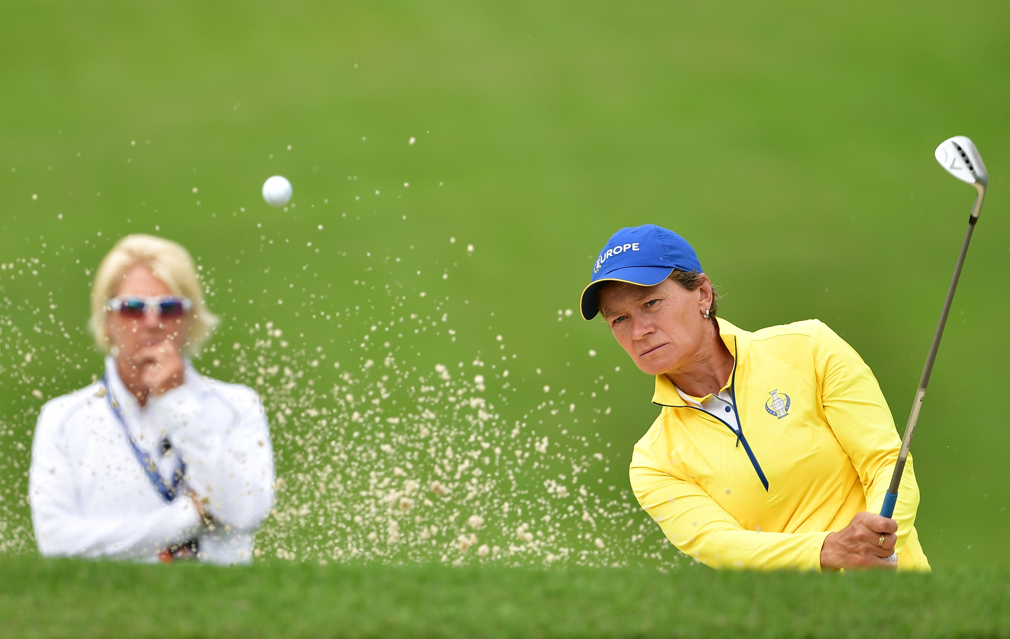 Kathryn Imrie keeping a close watch on her friend Catriona Matthew during practice for the Solheim Cup at the Des Moines Country Club.