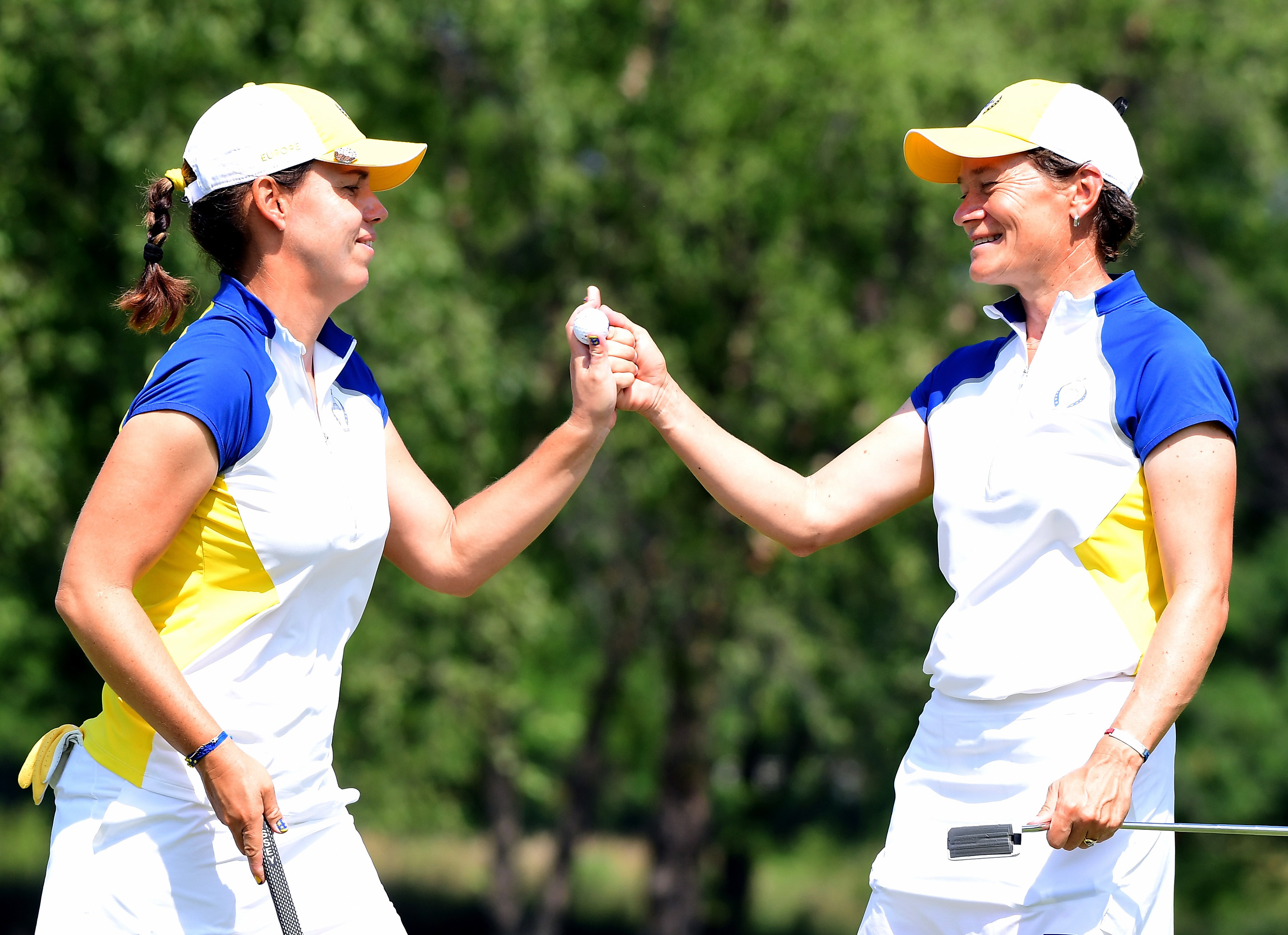 Catriona Matthew and Karine Icher celebrate their birdie on the 14th holeduring the morning foursomes matches of the Solheim Cup.