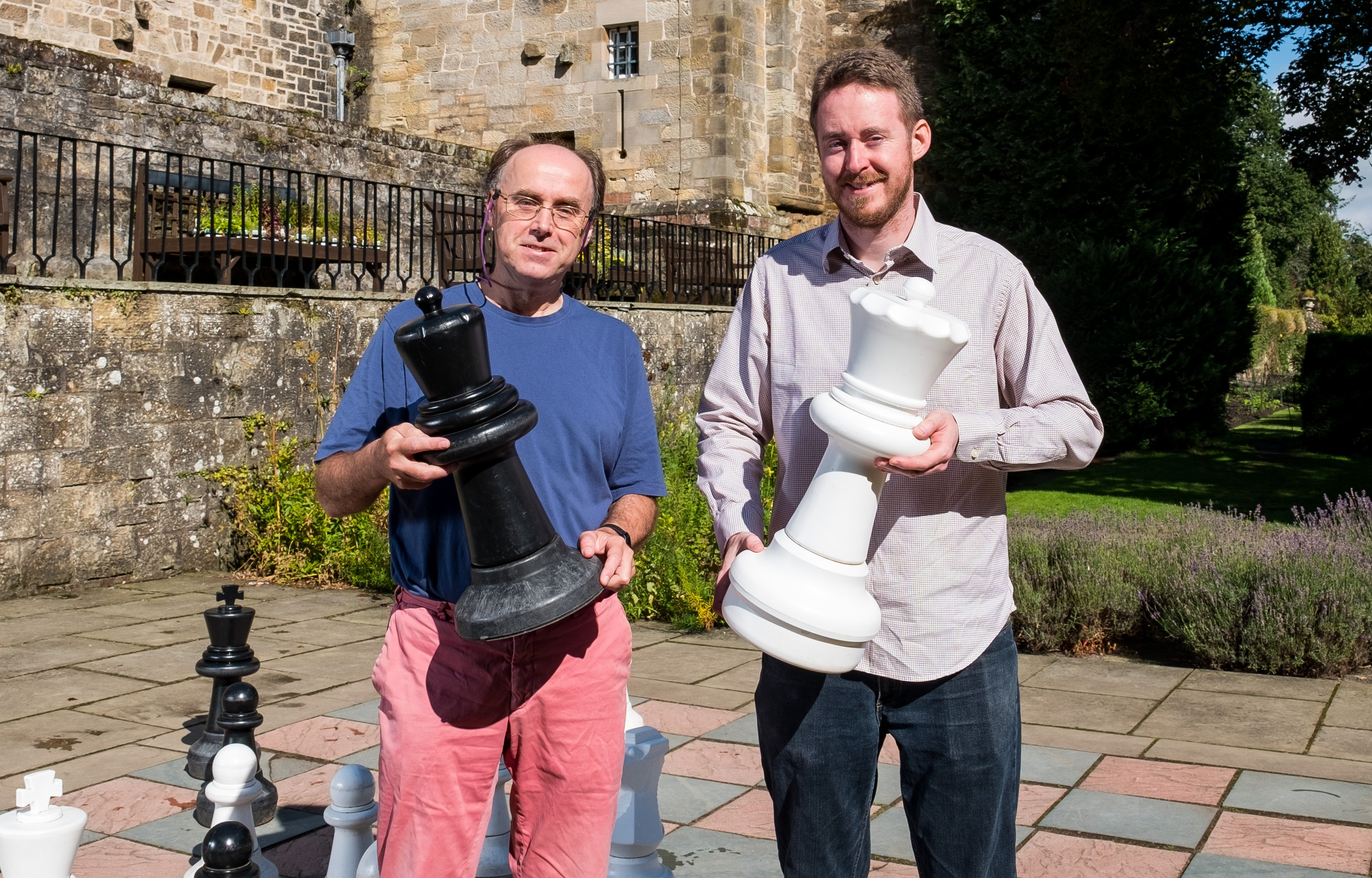 Professor Ian Gent and Dr Peter Nightingale attempt the puzzle with the giant chess set at Falkland Palace.