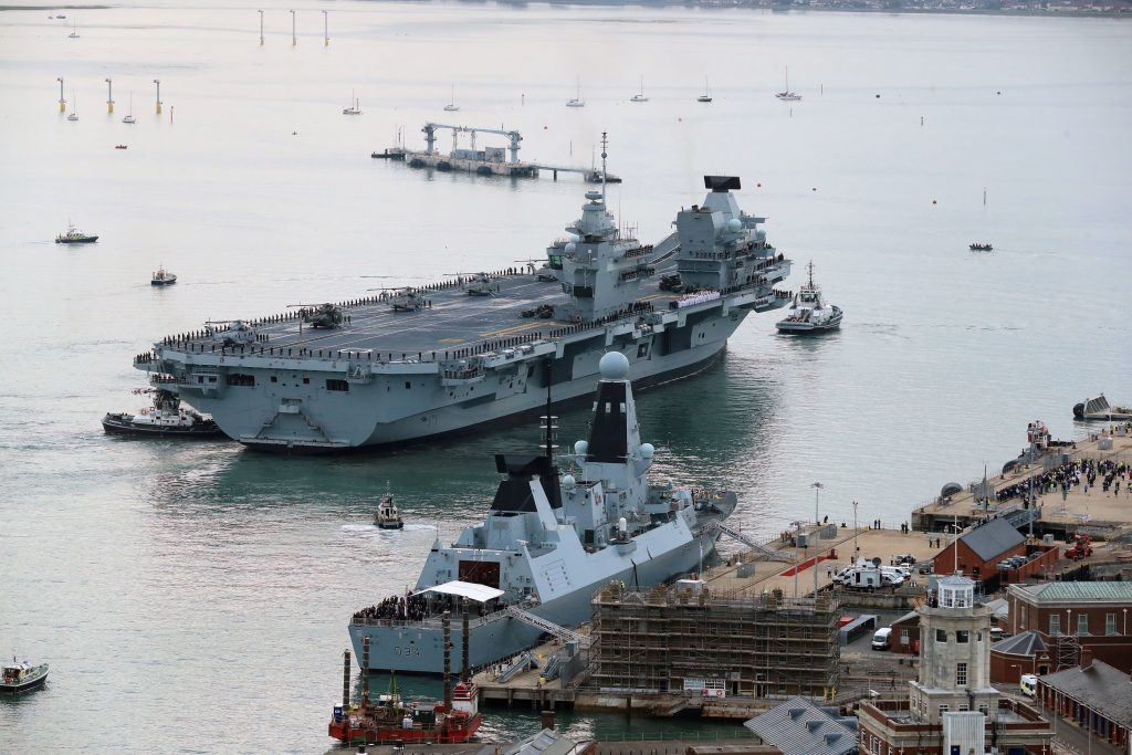 HMS Queen Elizabeth, the UK's newest aircraft carrier, arrives in Portsmouth.