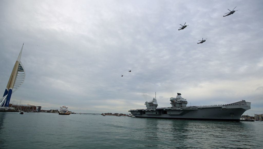 A helicopter fly past greets HMS Queen Elizabeth