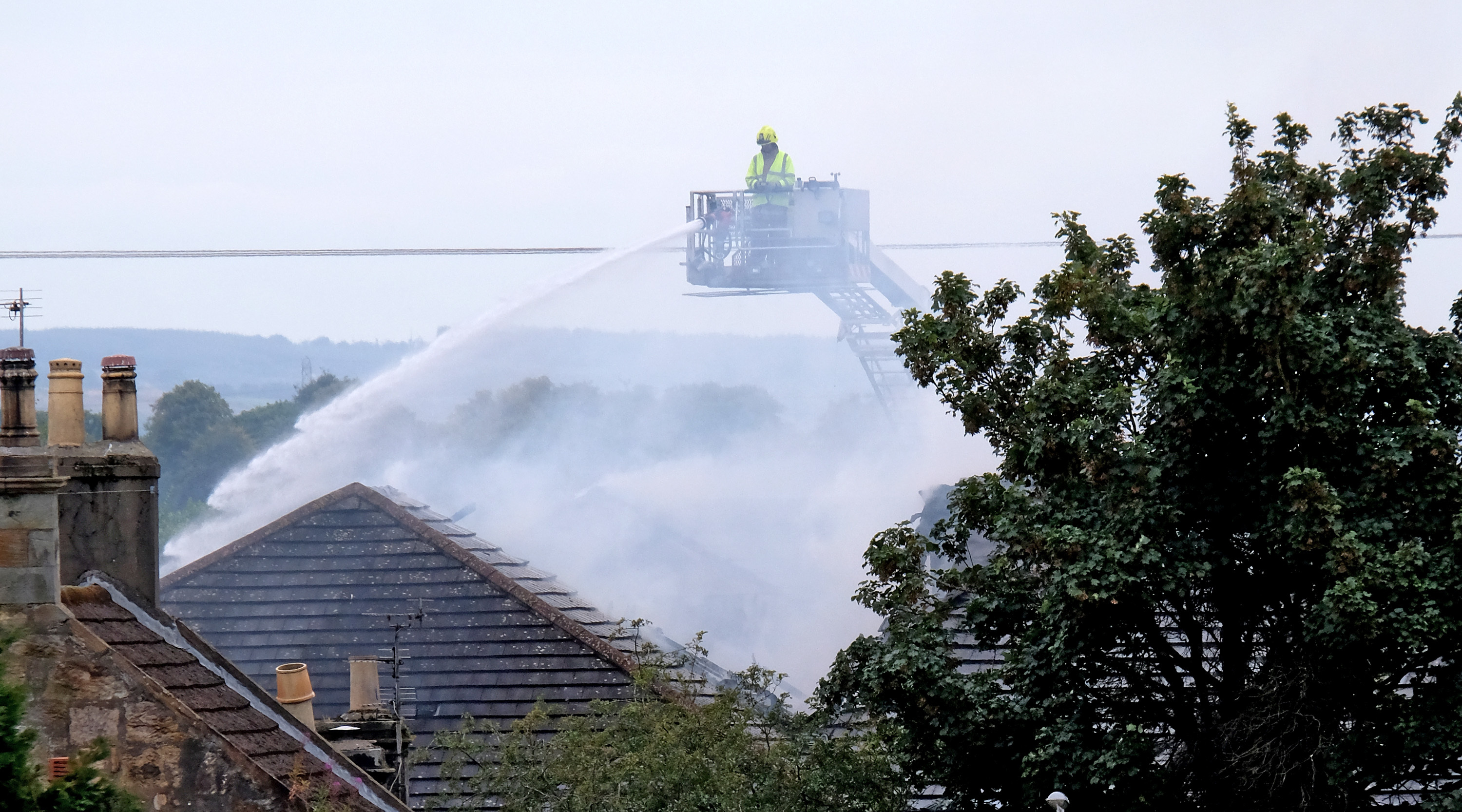 Firefighters battle the blaze