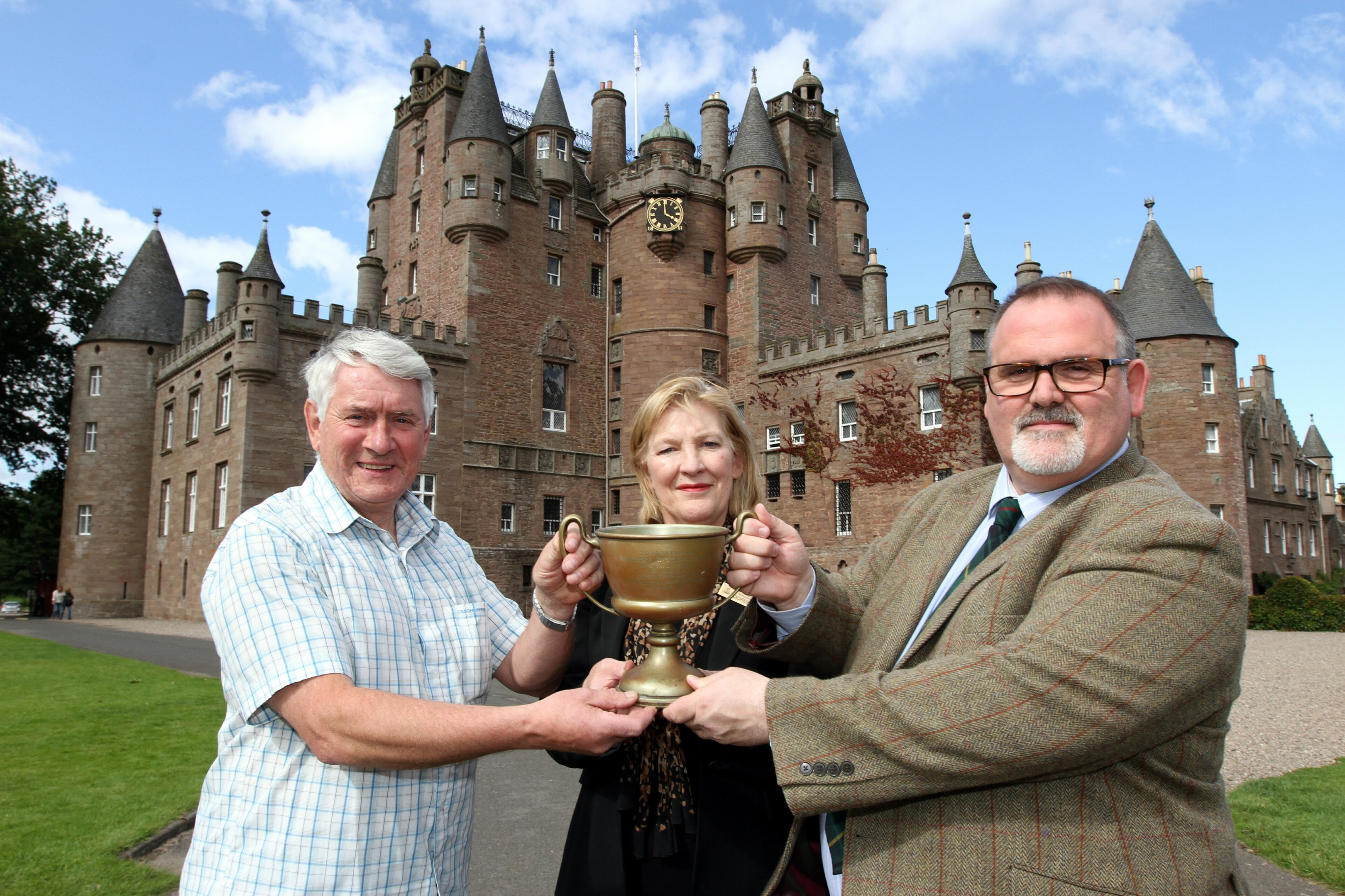 Dave Orr of Kirrie Show with Doreen Stout and Tommy Baxter of Glamis Castle.