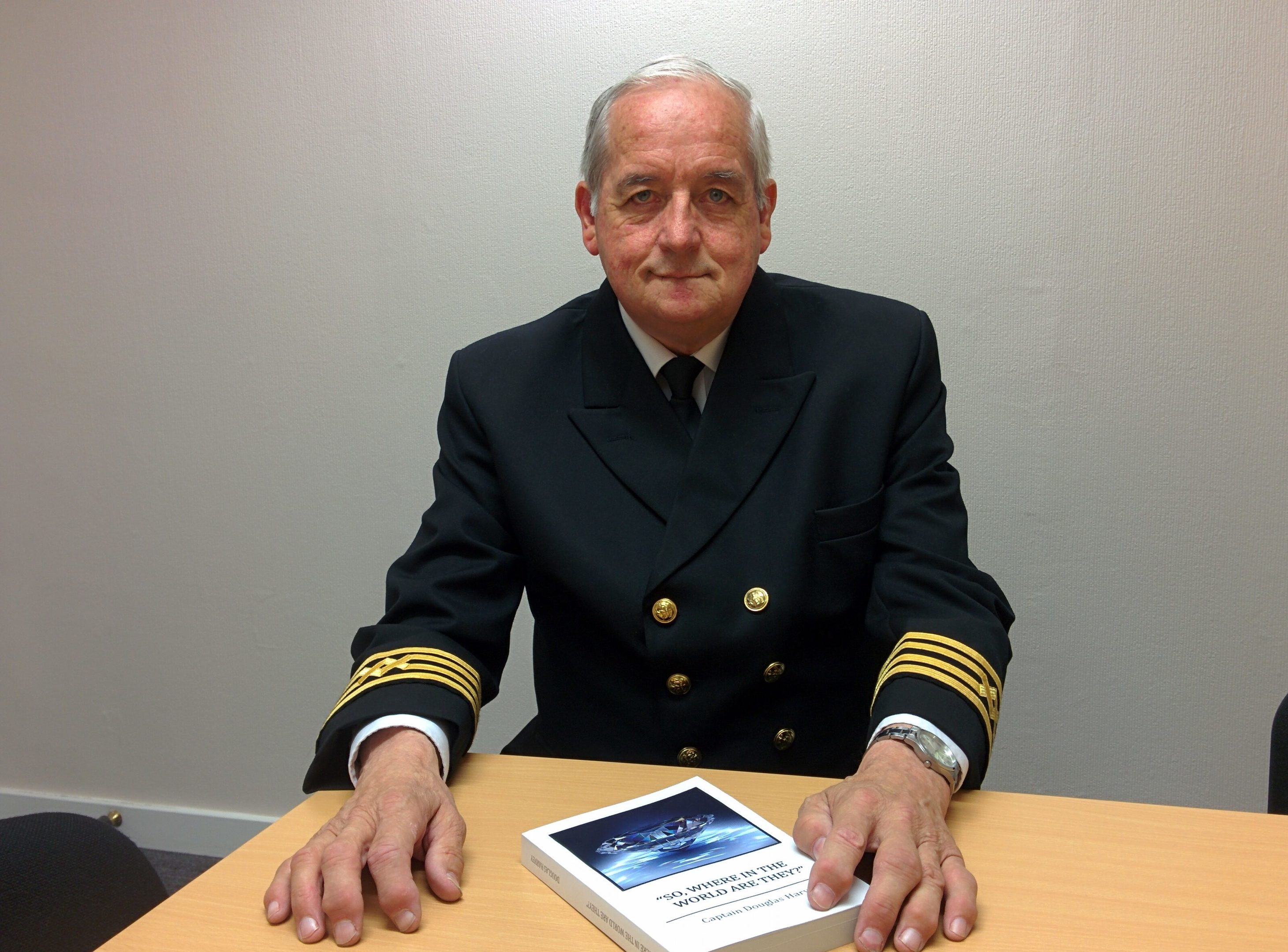 Captain Douglas Harvey with his latest book So, where in the world are they?