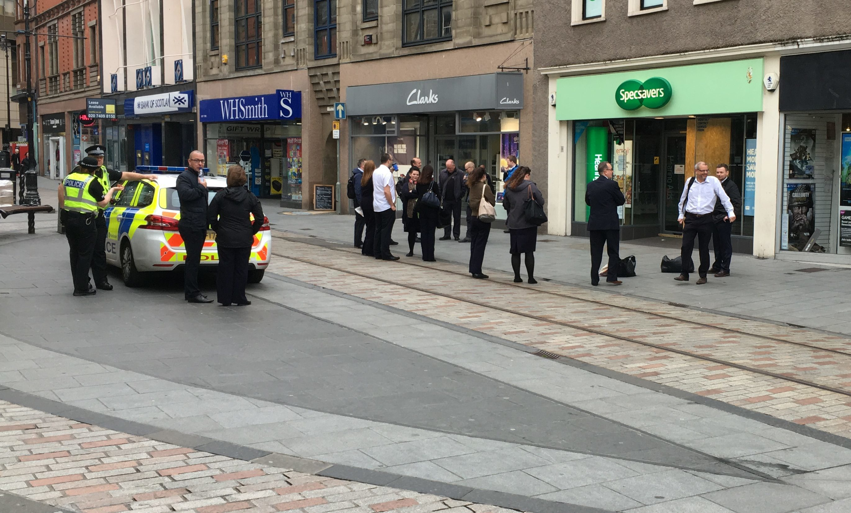 Staff and police outside Specsavers on Monday morning.