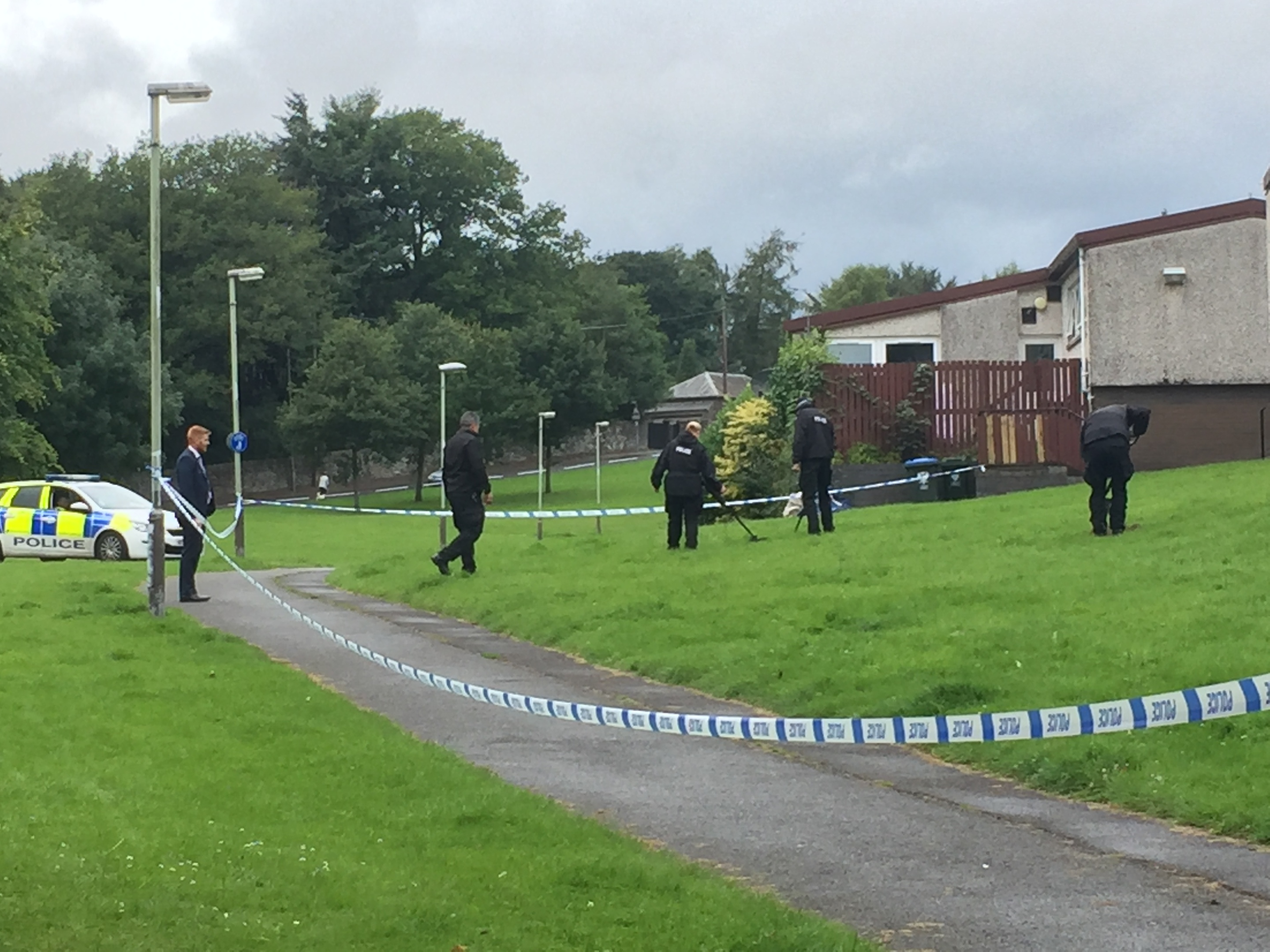 Police were seen with a metal detector in the area of the incident