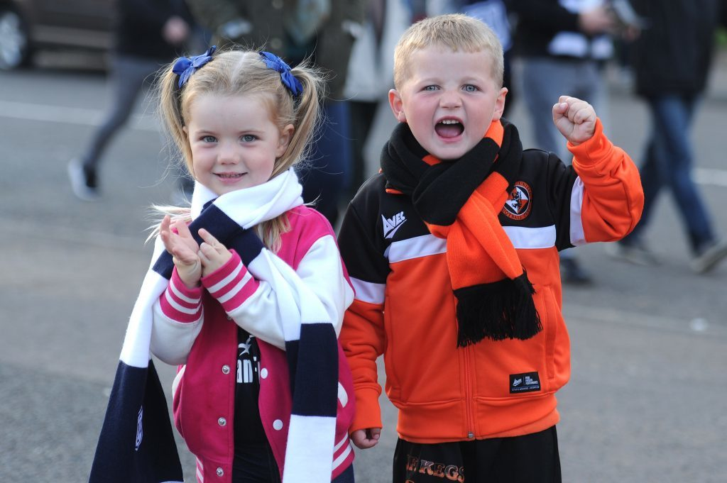 Georgia Duffy (3) and Lewis Adams (4) before the start of last month's Dundee derby. Both sets of fans will be asked to make as much noise as possible at home games in October.