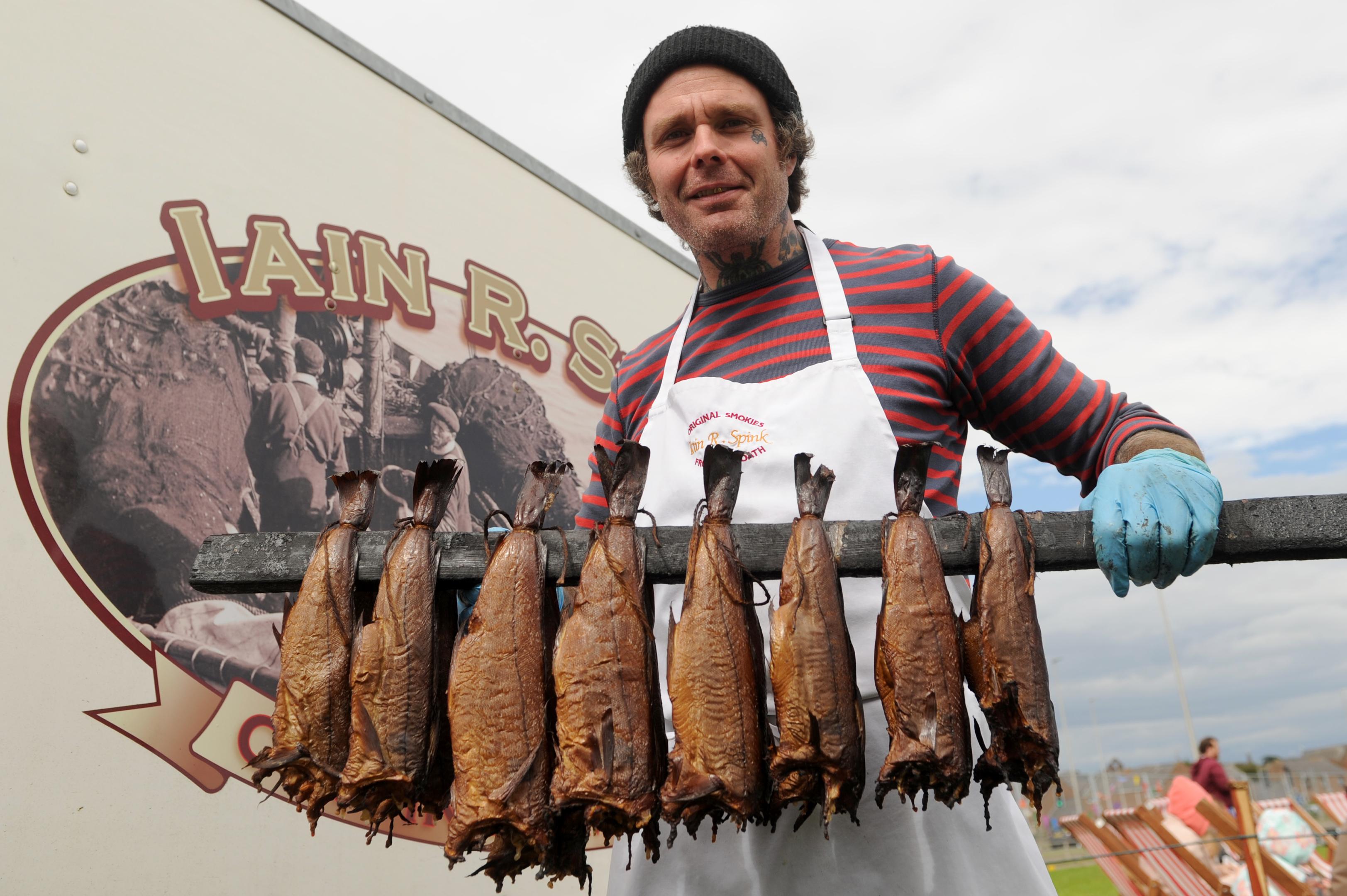 Robbie Boyd serving up smokies last year