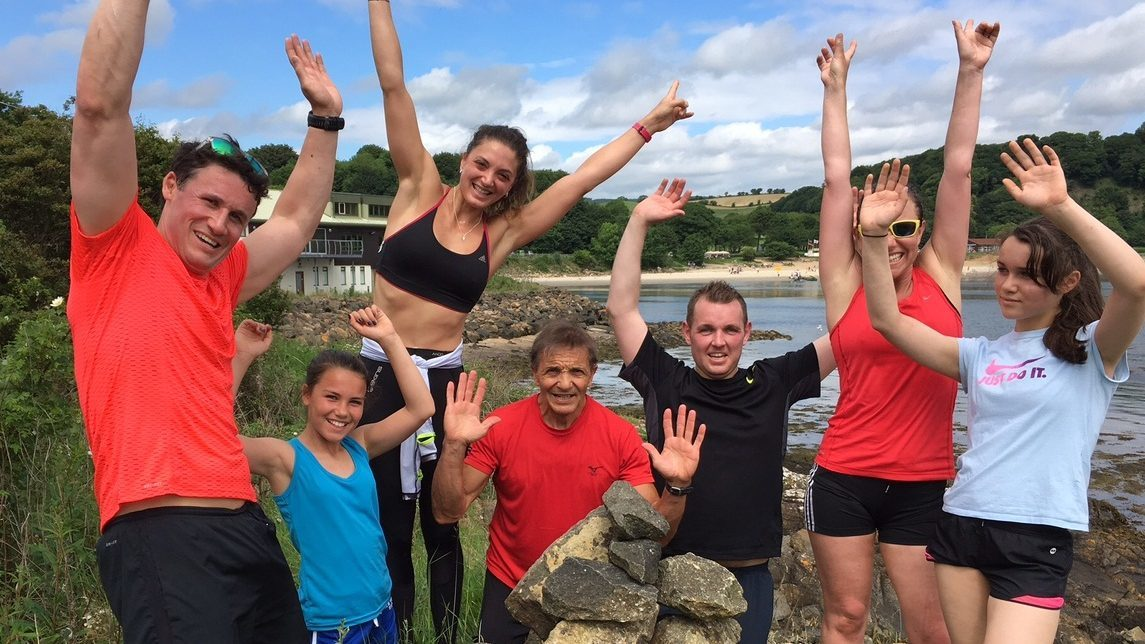 Mike, with his family's Total Warrior challengers
