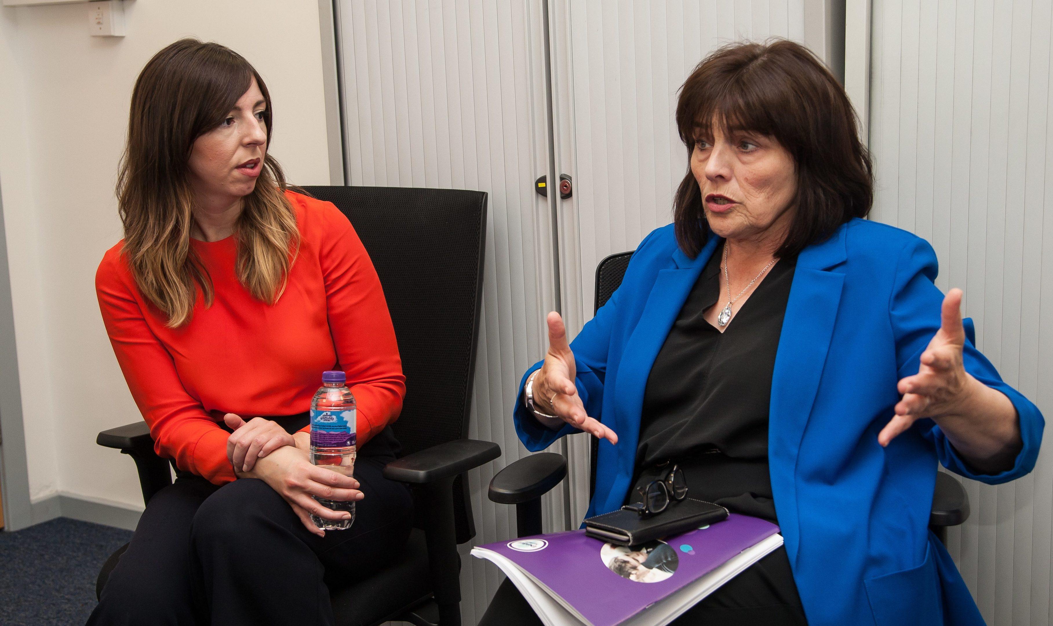 ENABLE Scotland executive director Jan Savage talks to Jeane Freeman
