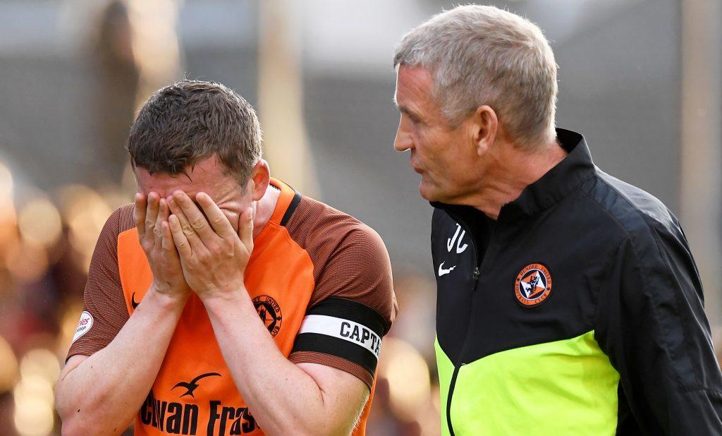 Dundee United's Tam Scobbie is taken off injured